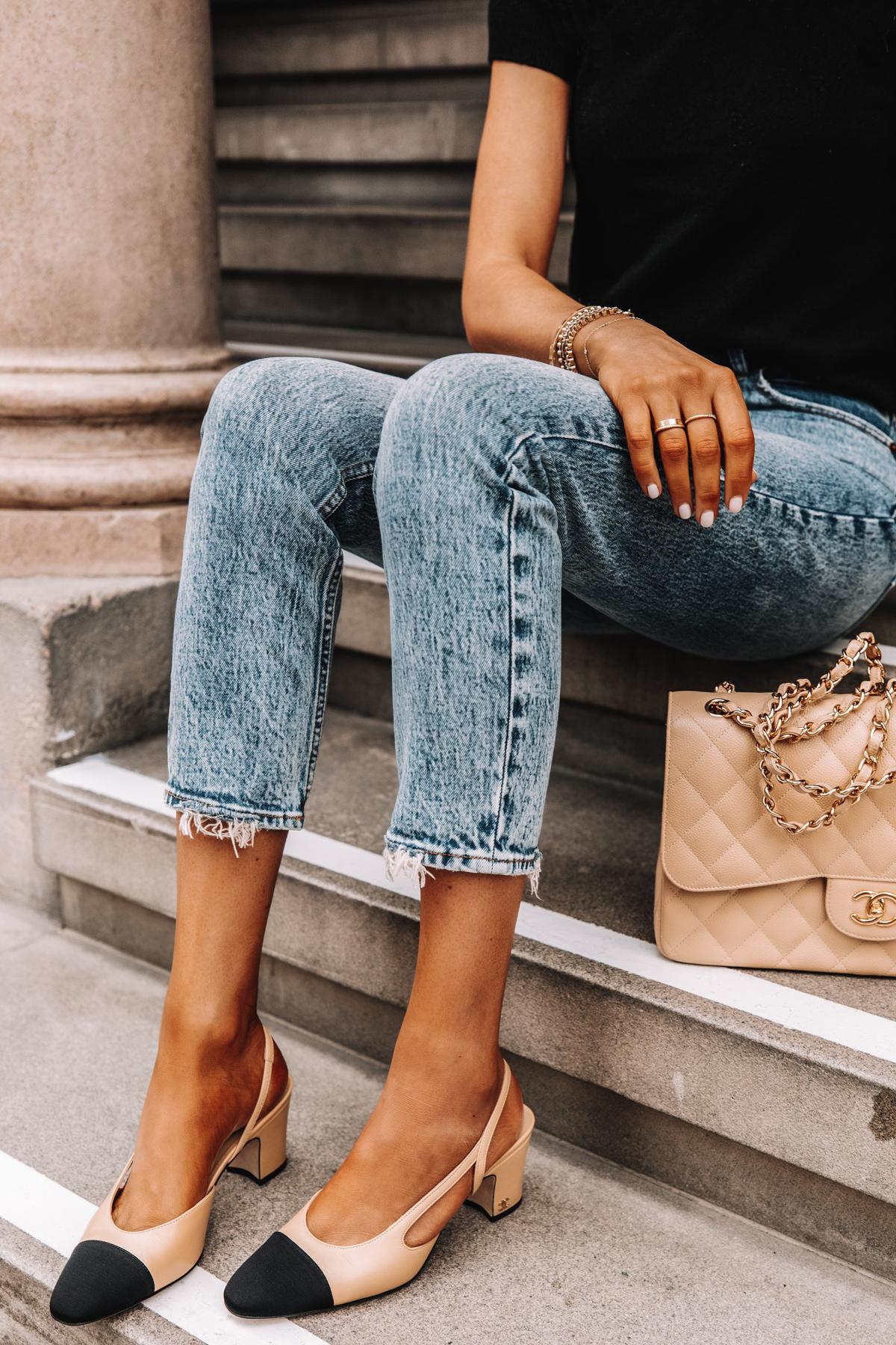 Fashion Jackson Wearing Short Sleeve Black Sweater High Rise Jeans Chanel Slingbacks Chanel Beige Jumbo Handbag 2