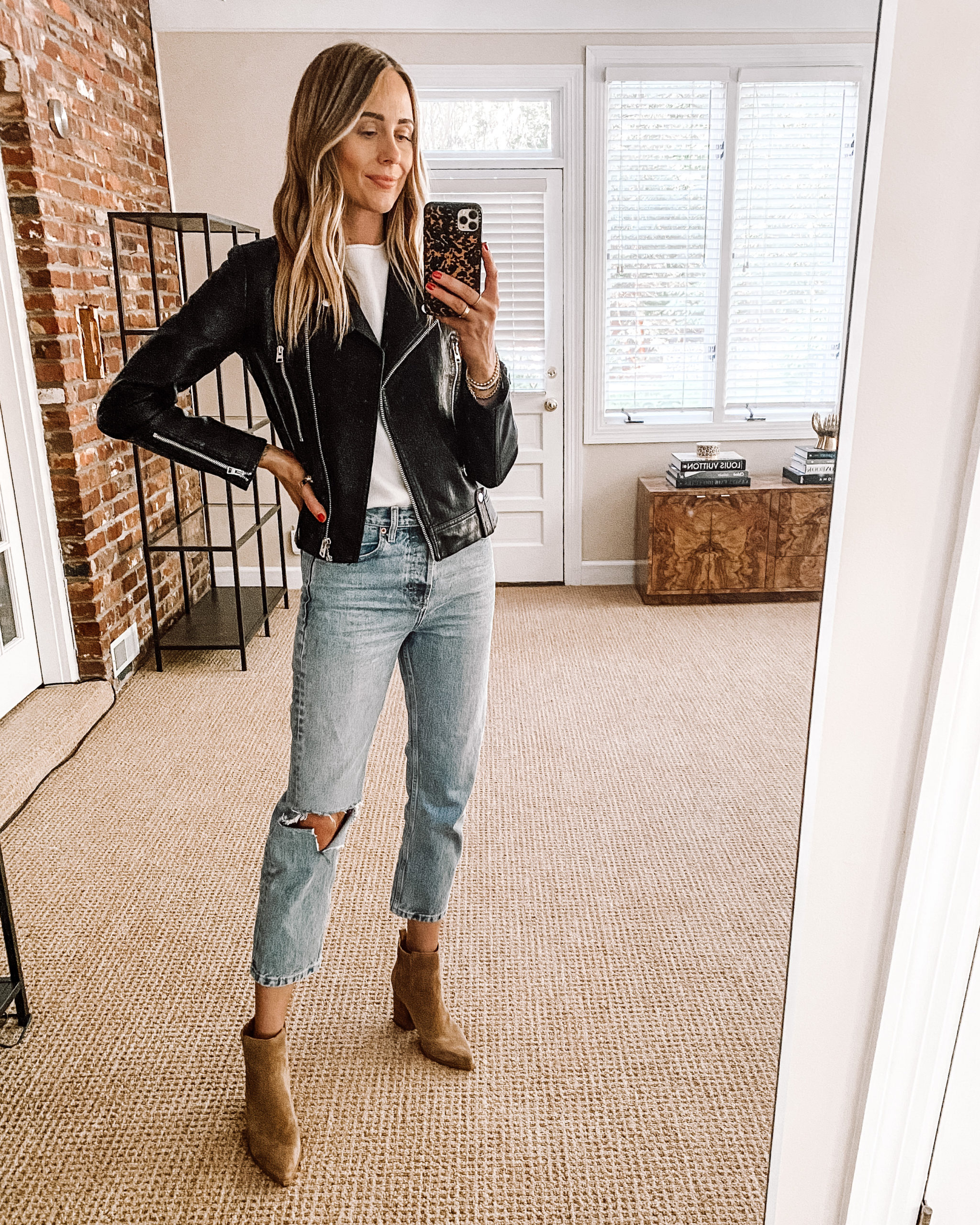 Fashion Jackson Nordstrom Anniversary Sale Black leather Jacket White Tshirt White Ripped Jeans Booties