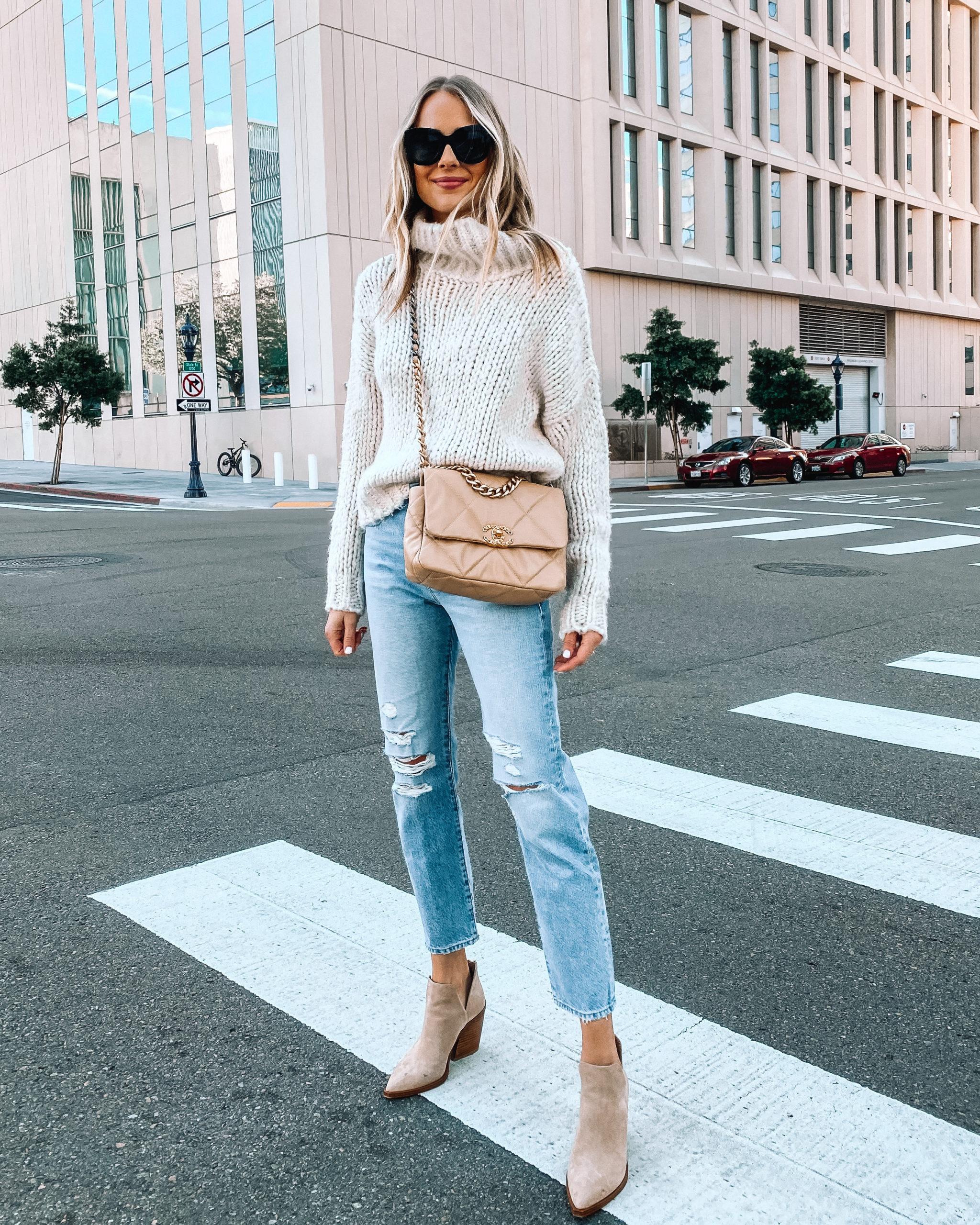 Fashion Jackson Wearing Beige Turtleneck Oversized Knit Sweater Ripped Jeans Tan Booties Chanel 19 Handbag
