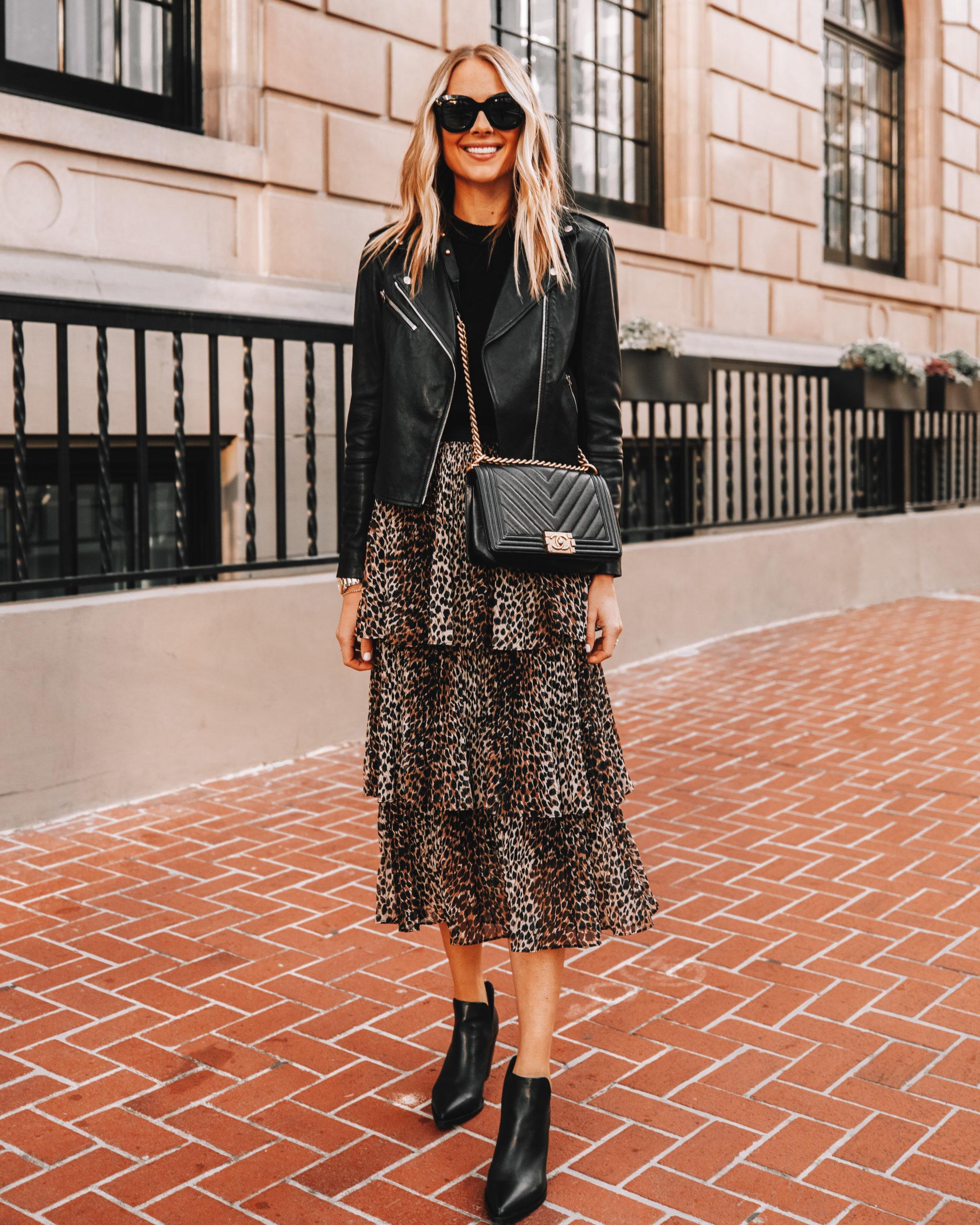 Fashion Jackson Wearing Black Leather Jacket Black Leopard Midi Skirt Black Booties Black Chanel Boy Bag