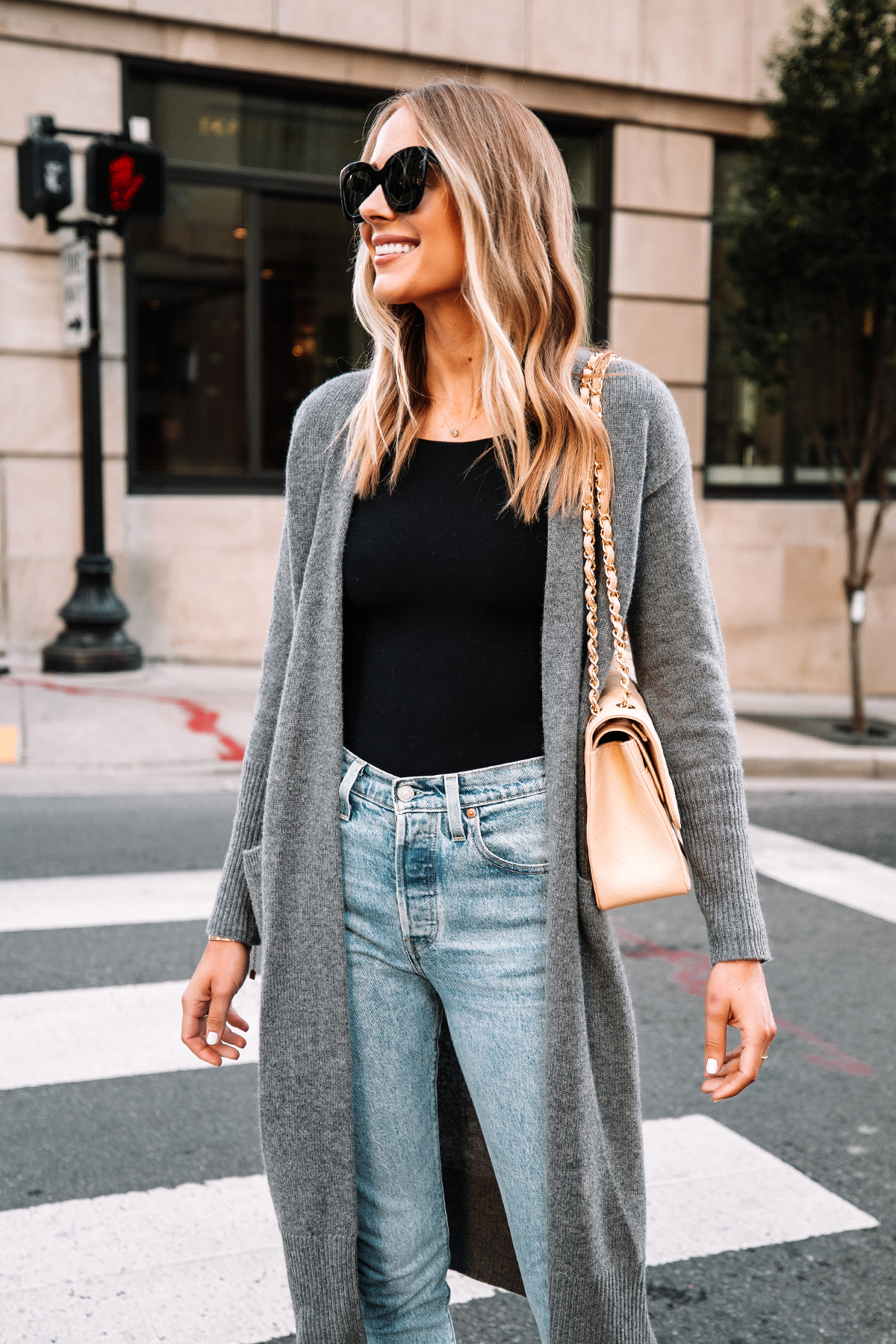 Fashion Jackson Wearing Long Grey Cardigan Black Bodysuit Levis 501 Jeans Chanel Jumbo Beige Handbag 1