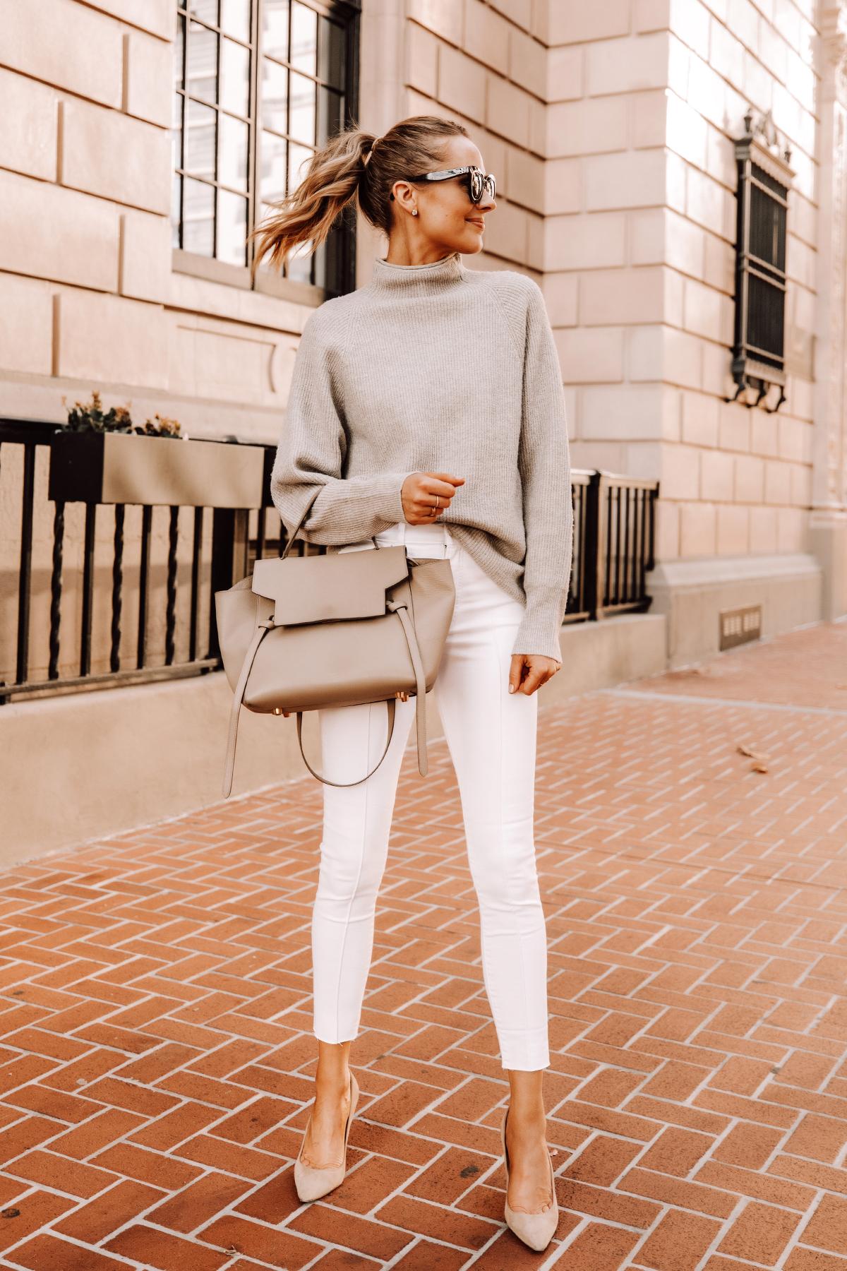 Fashion Jackson Wearing Beige Mockneck Sweater White Skinny Jeans Nude Pumps Celine Belt Bag