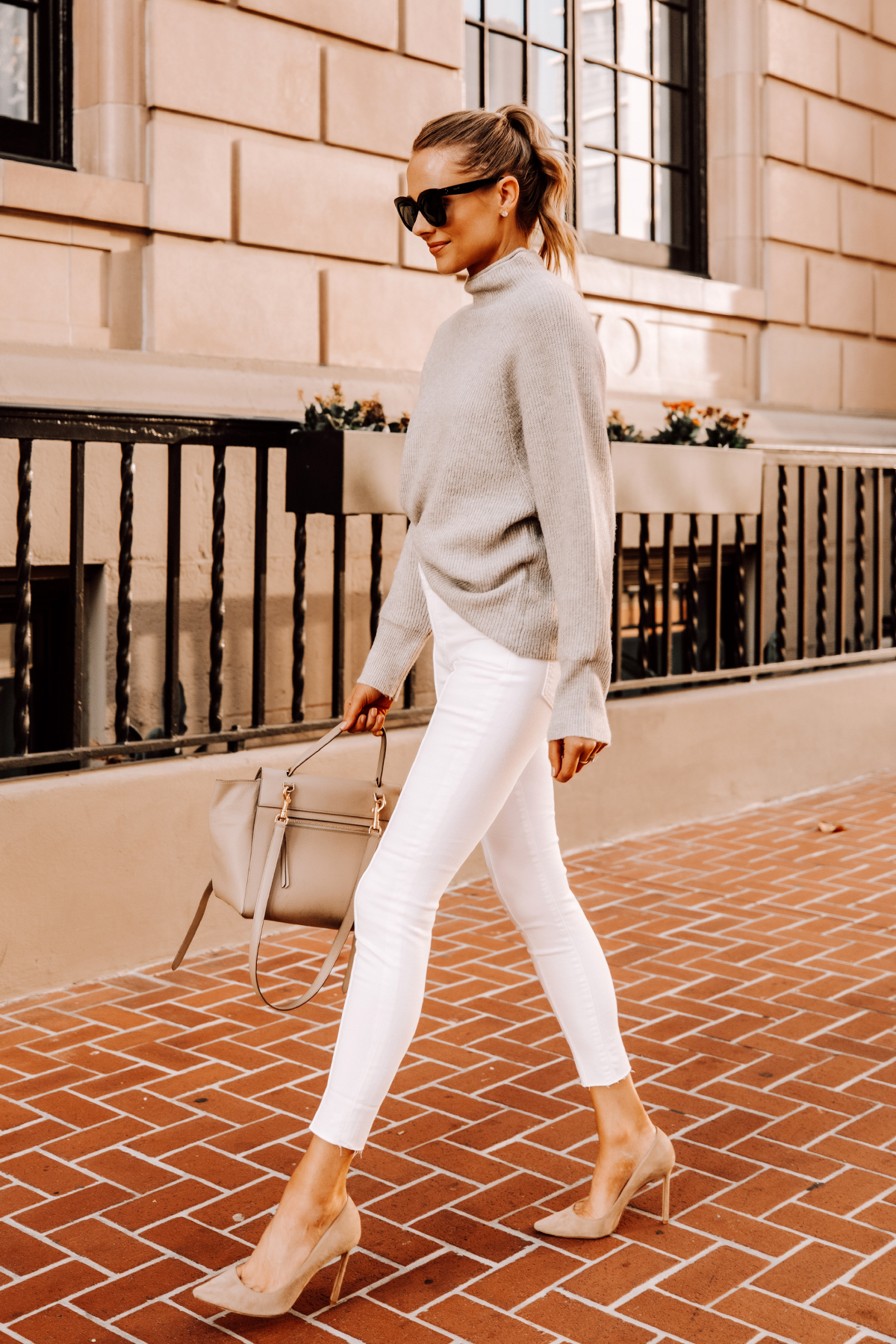 Fashion Jackson Wearing Beige Mockneck Sweater White Skinny Jeans Nude Pumps