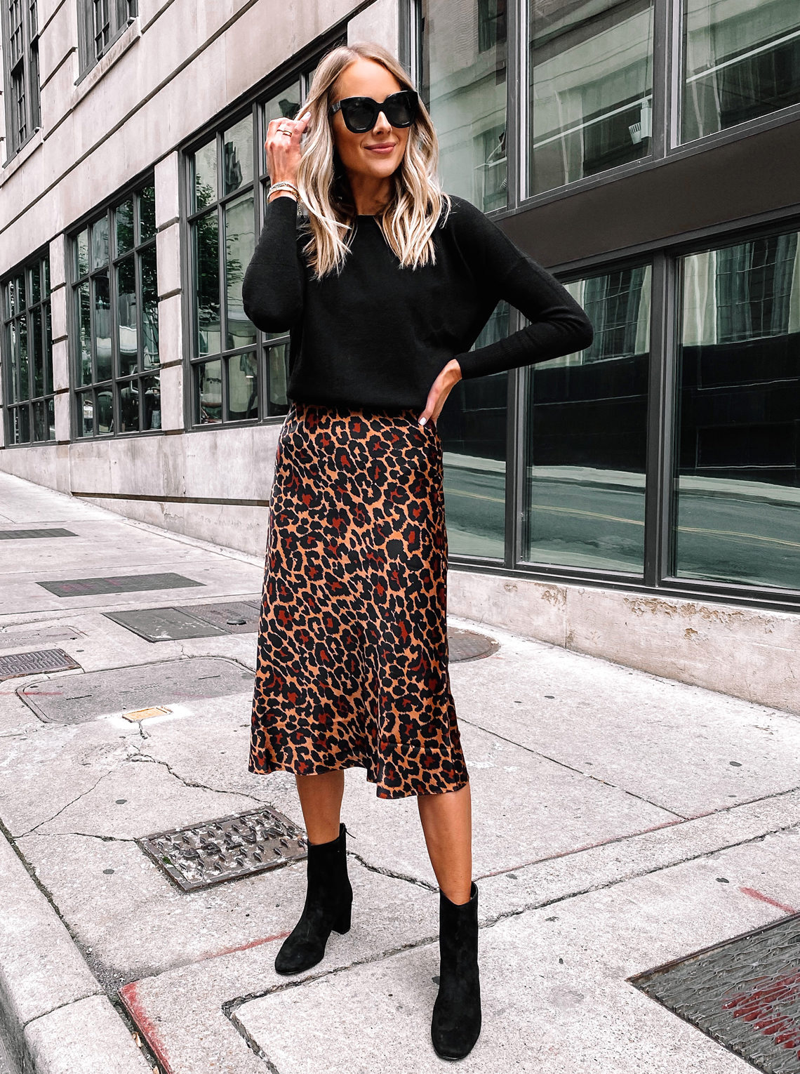 Fashion Jackson Wearing Black Sweater Leopard Midi Skirt Black Booties 1
