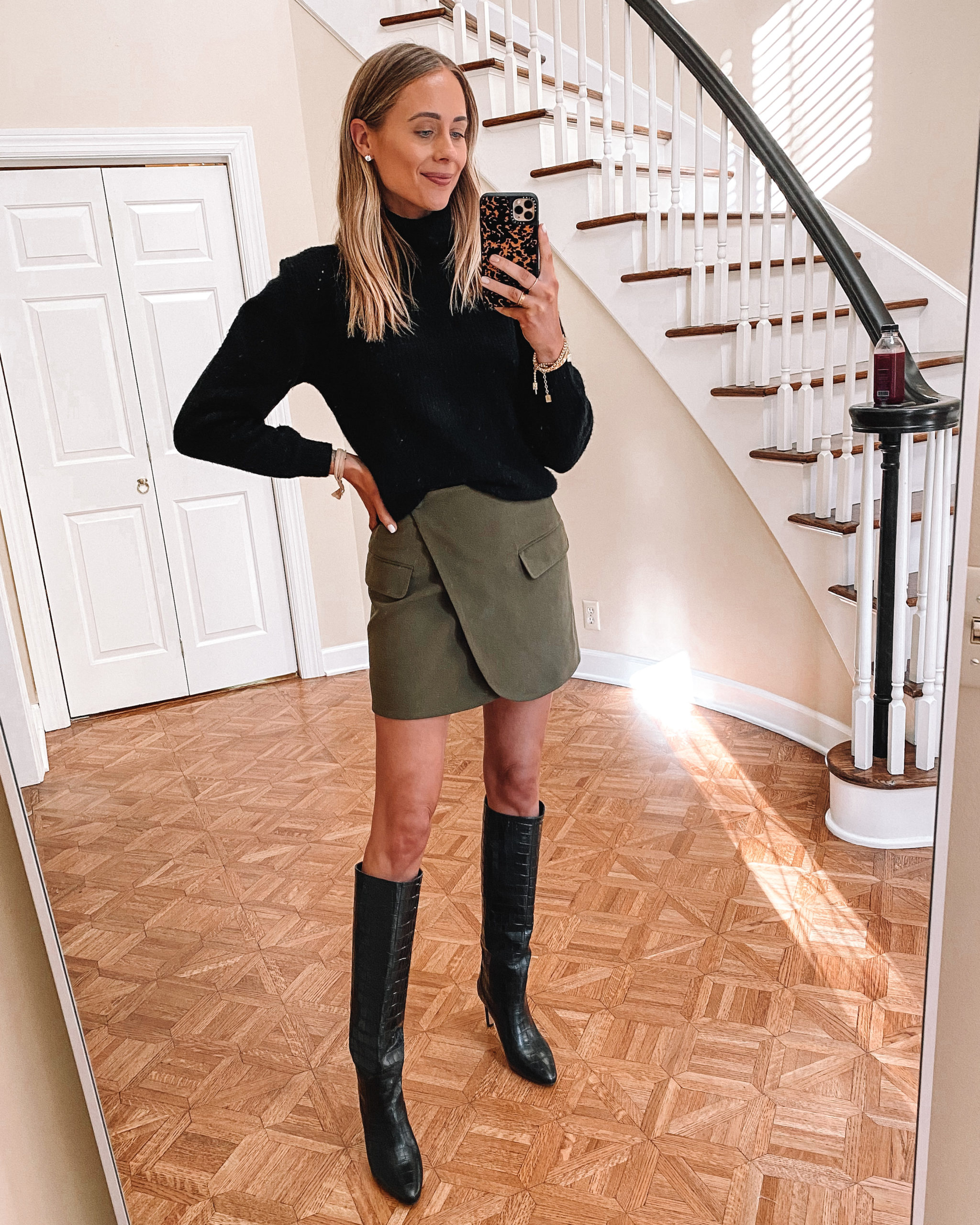 Fashion Jackson Wearing Black Sweater Olive Green Wrap Skirt Knee High Black Boots