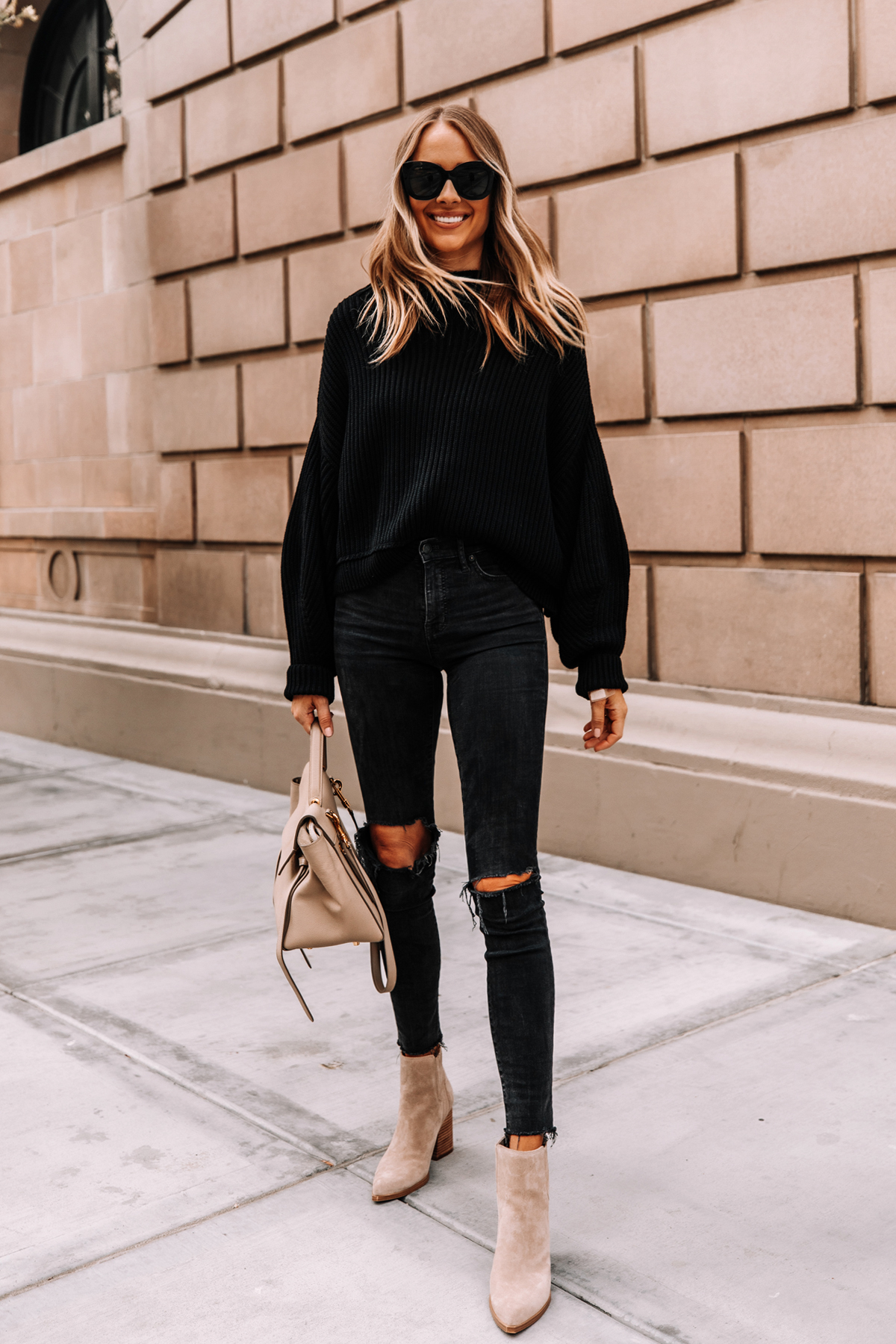 Fashion Jackson Wearing Free People Black Emmy Sweater Madewell Black Ripped Skinny Jeans Tan Suede Booties 1
