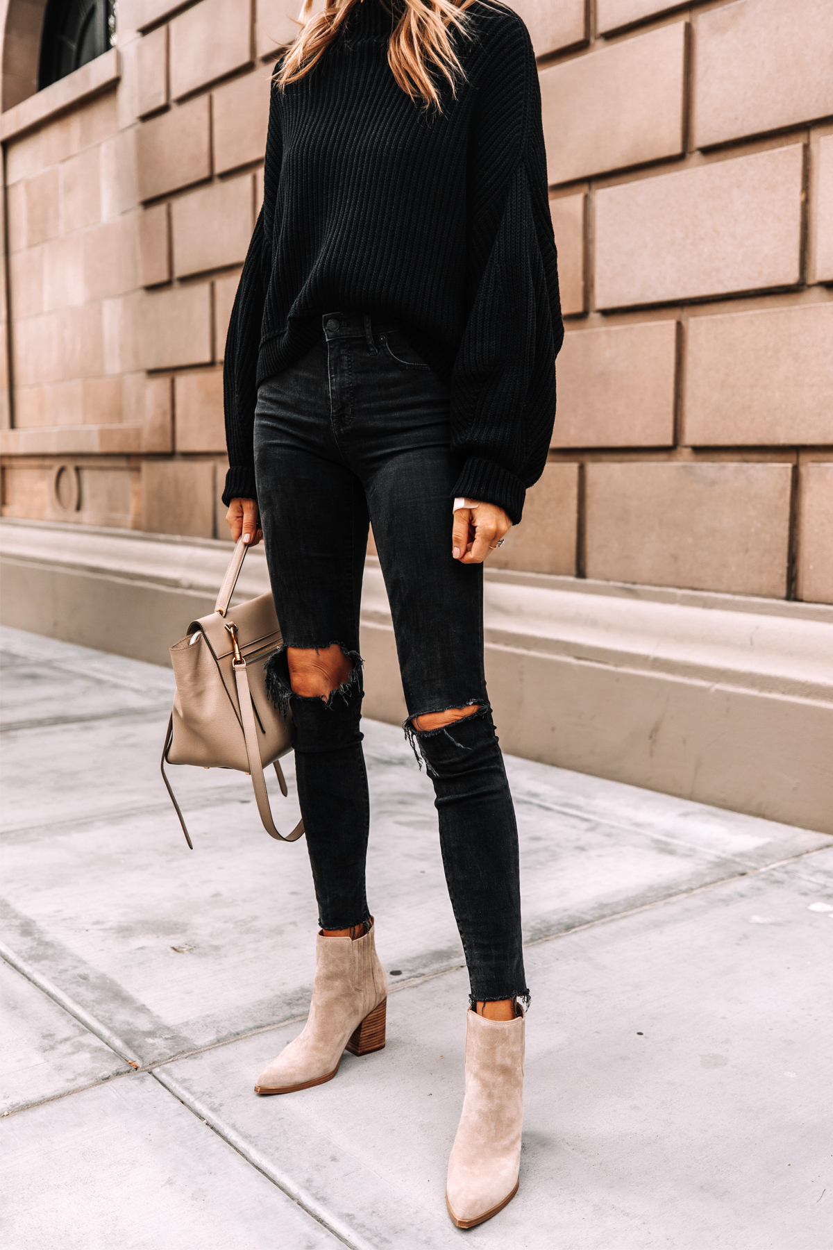 Fashion Jackson Wearing Free People Black Emmy Sweater Madewell Black Ripped Skinny Jeans Tan Suede Booties