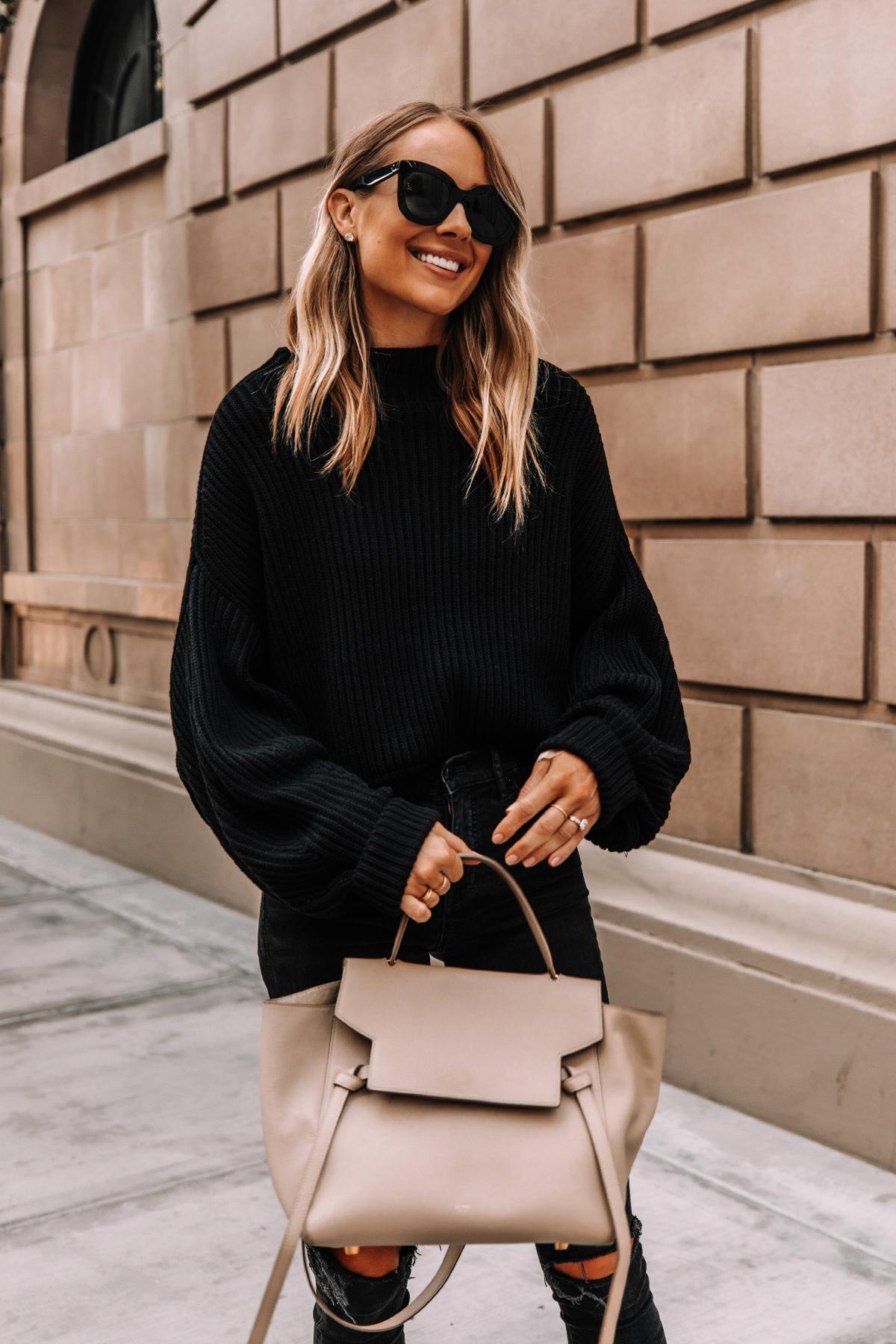 Fashion Jackson Wearing Free People Emmy Black Sweater Celine Mini Belt Bag Black Ripped Jeans