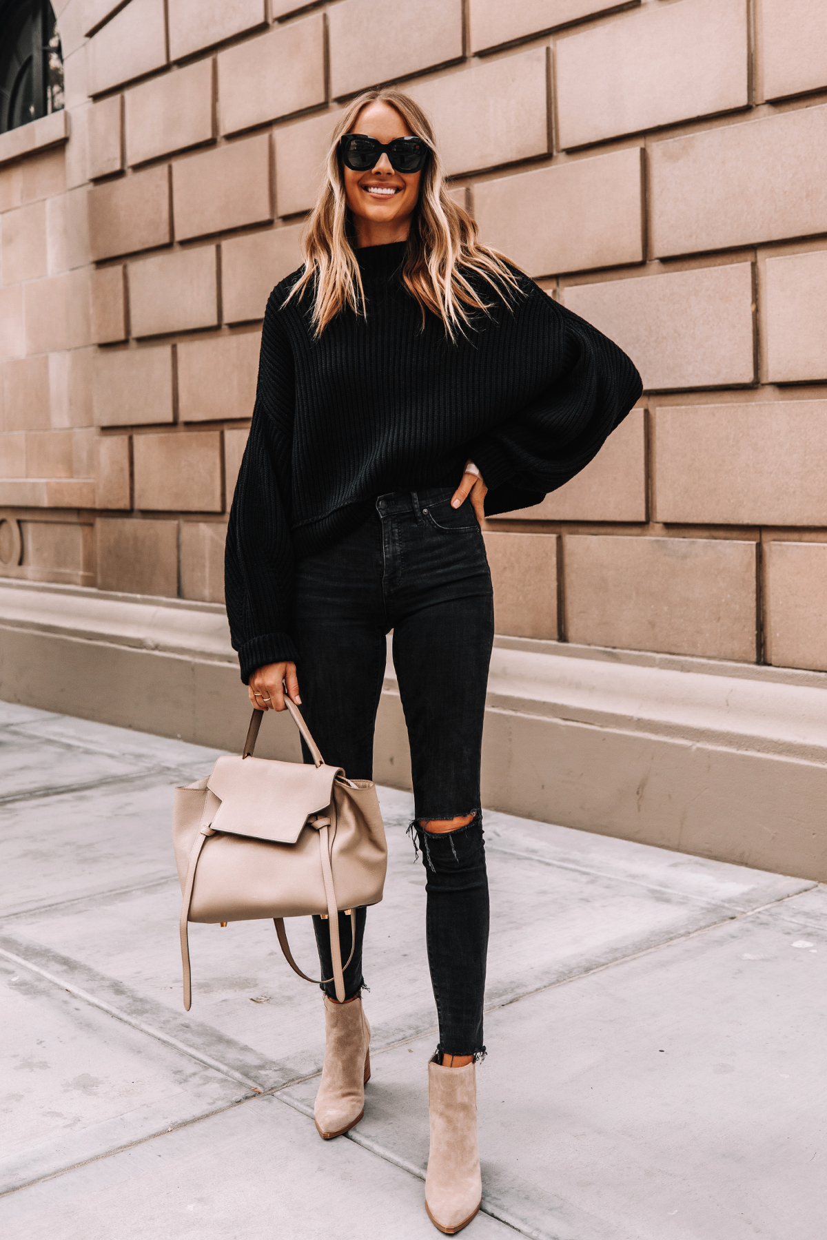 Fashion Jackson Wearing Free People Emmy Black Sweater Madewell Black Skinny Jeans Marc Fisher Oshay Cloud Suede Booties Celine Belt Bag
