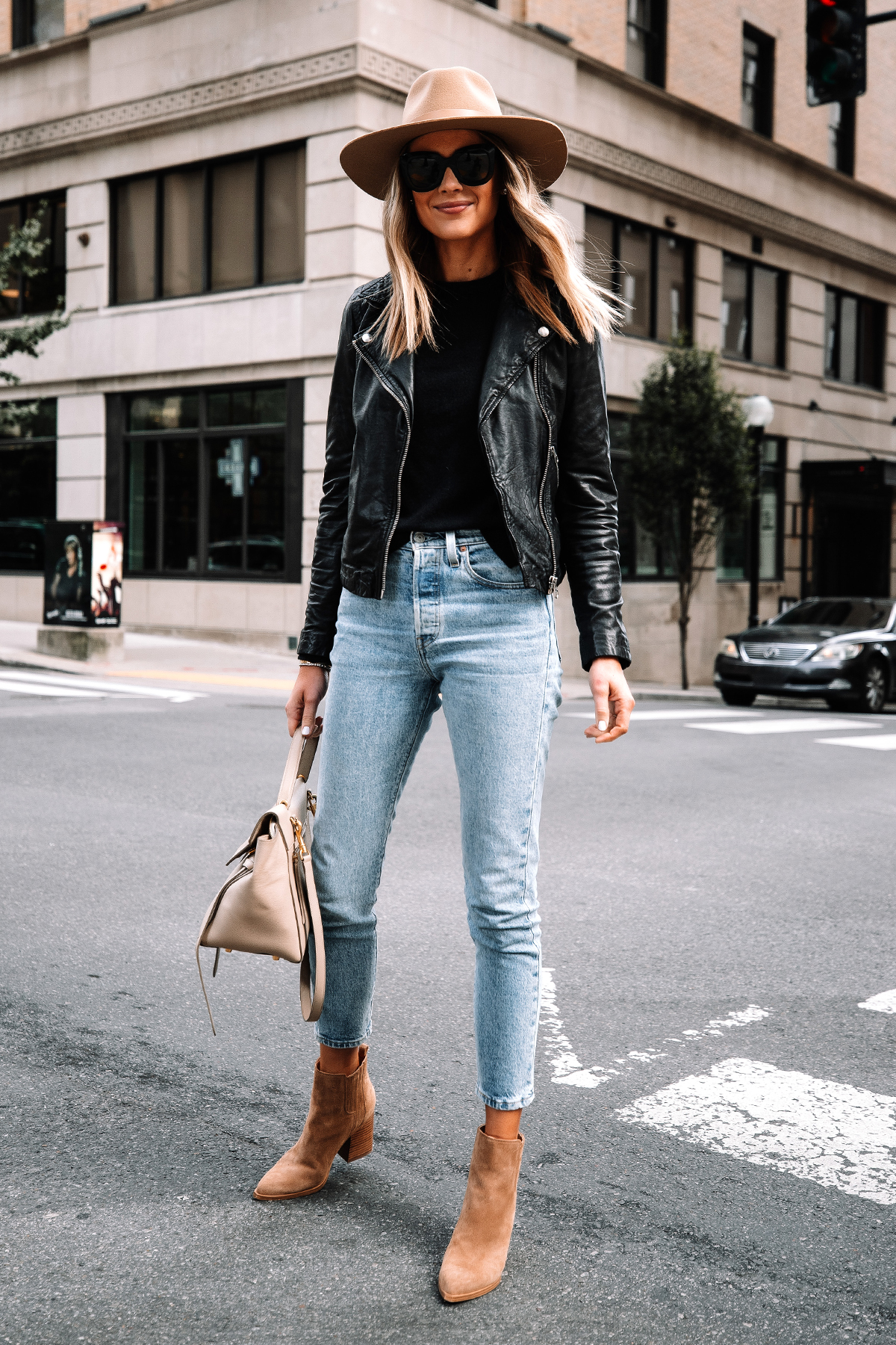 Fashion Jackson Wearing Madewell Black Leather Jacket Black Sweater Levis Jeans Tan Suede Booties Rag and Bone Tan Fall Hat Street Style