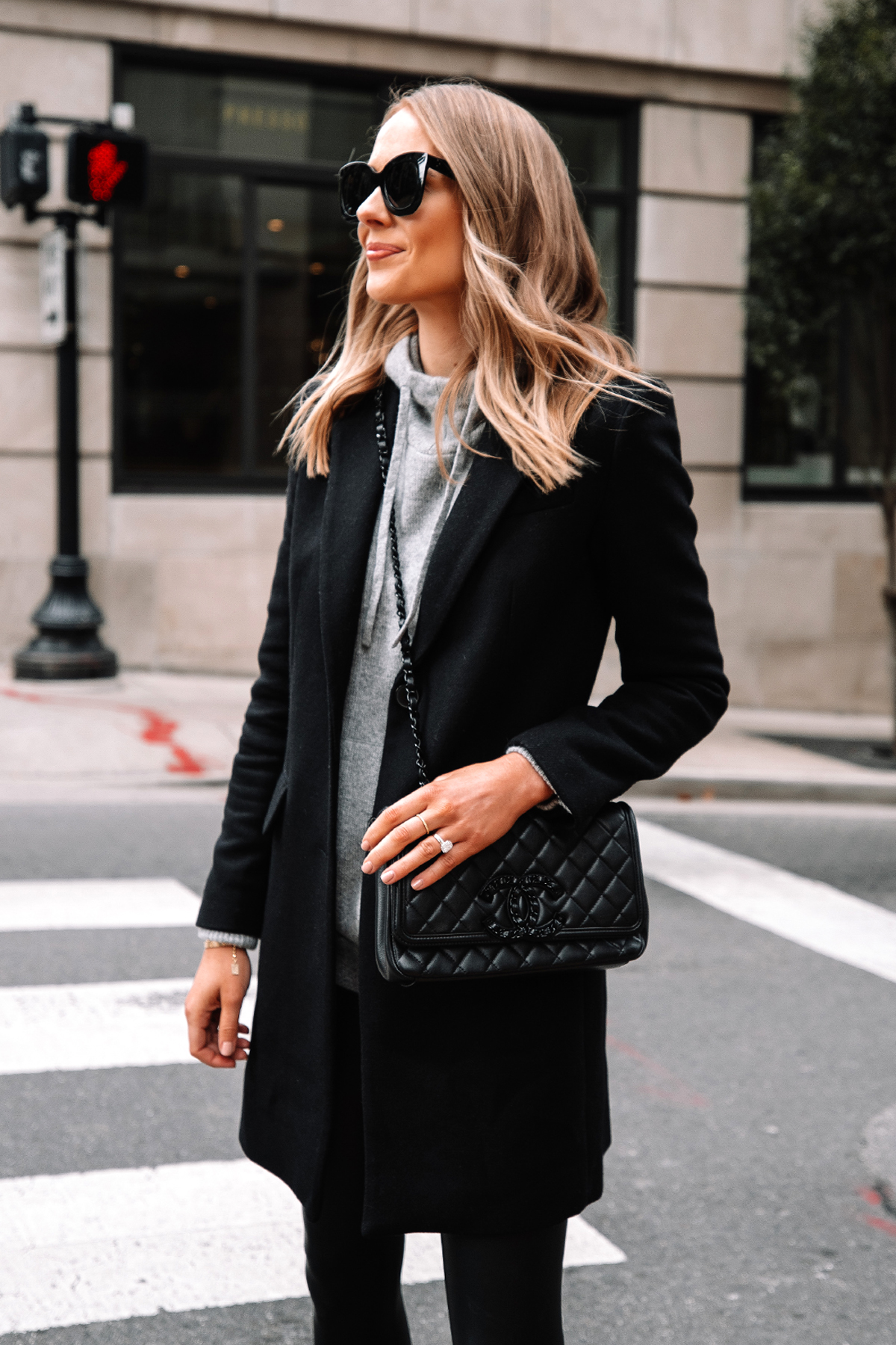 Fashion Jackson Wearing Black Wool Coat Grey Sweater Commando Black Faux Leather Leggings Black Chanel Filigree Handbag 1