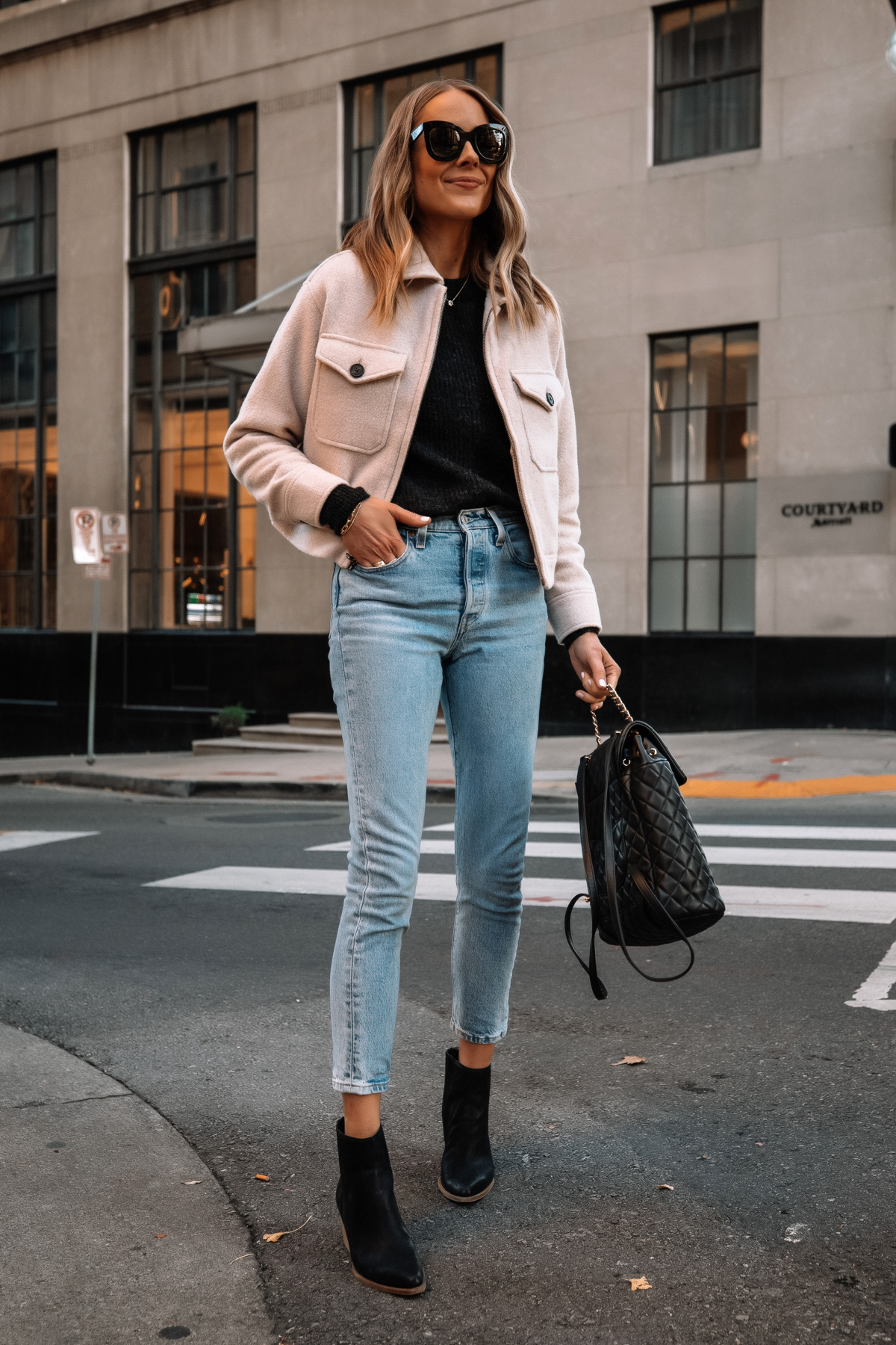 Fashion Jackson Wearing Everlane Mackinaw Jacket Black Sweater Jeans Black Booties Street Style Outfit 1