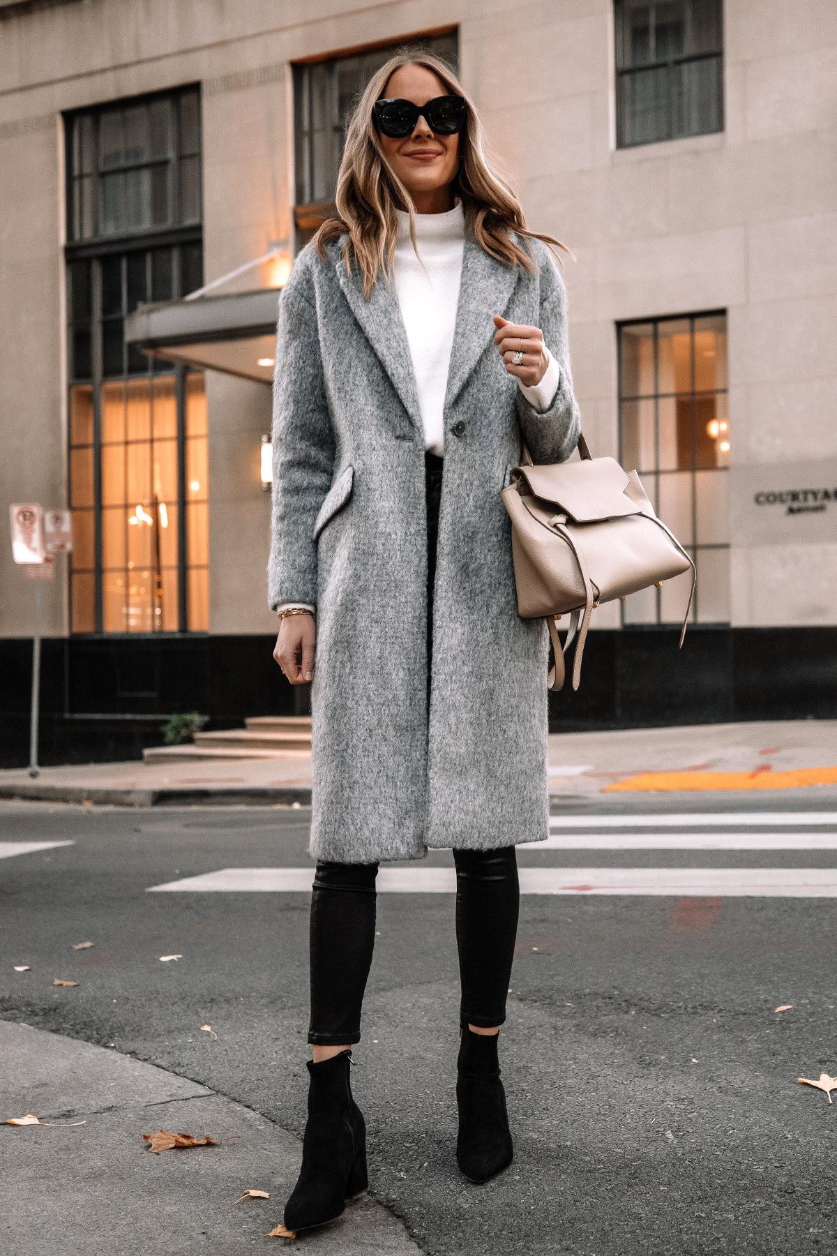 Fashion Jackson Wearing Express Long Grey Coat White Sweater Black Coated Skinny Jeans Black Suede Booties Winter Outfit Street Style 2