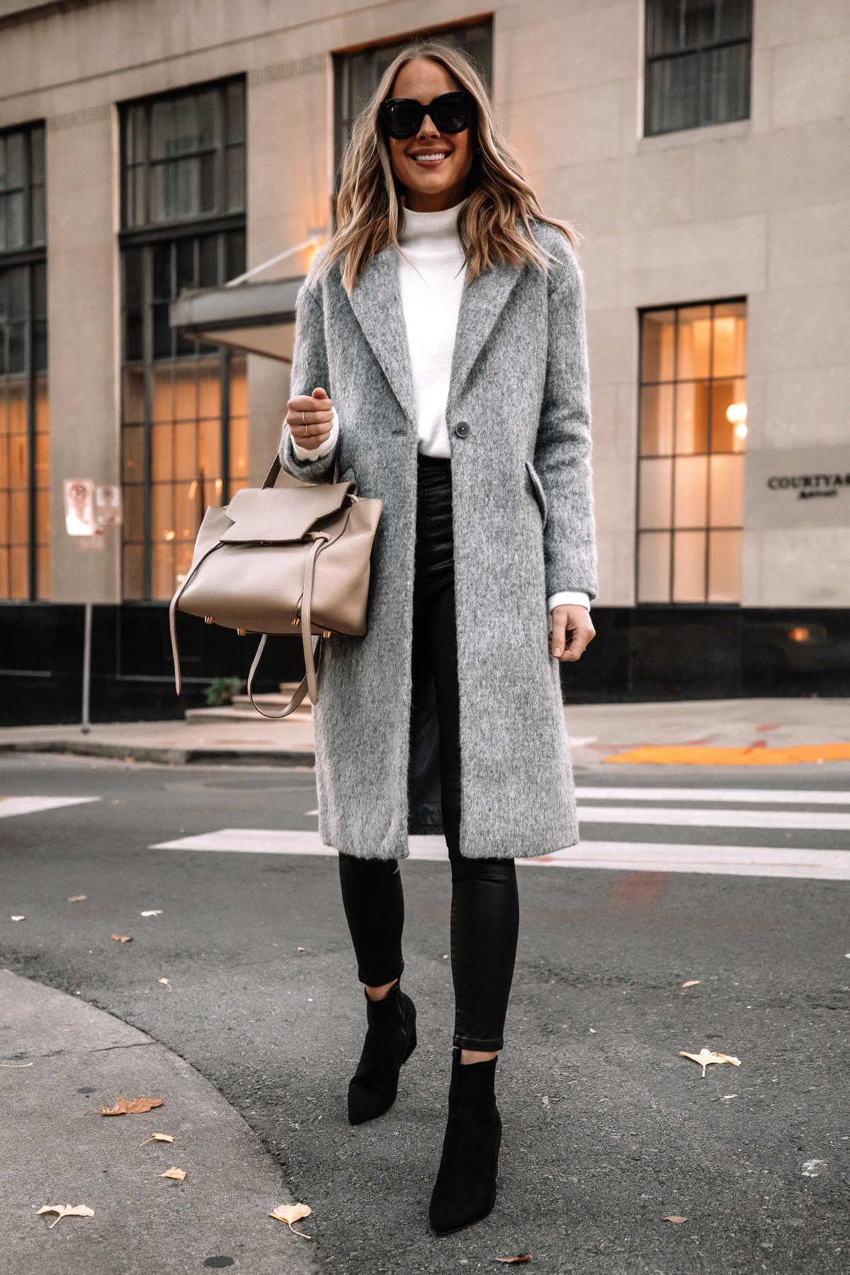Fashion Jackson Wearing Express Long Grey Coat White Sweater Black Coated Skinny Jeans Black Suede Booties Winter Outfit Street Style