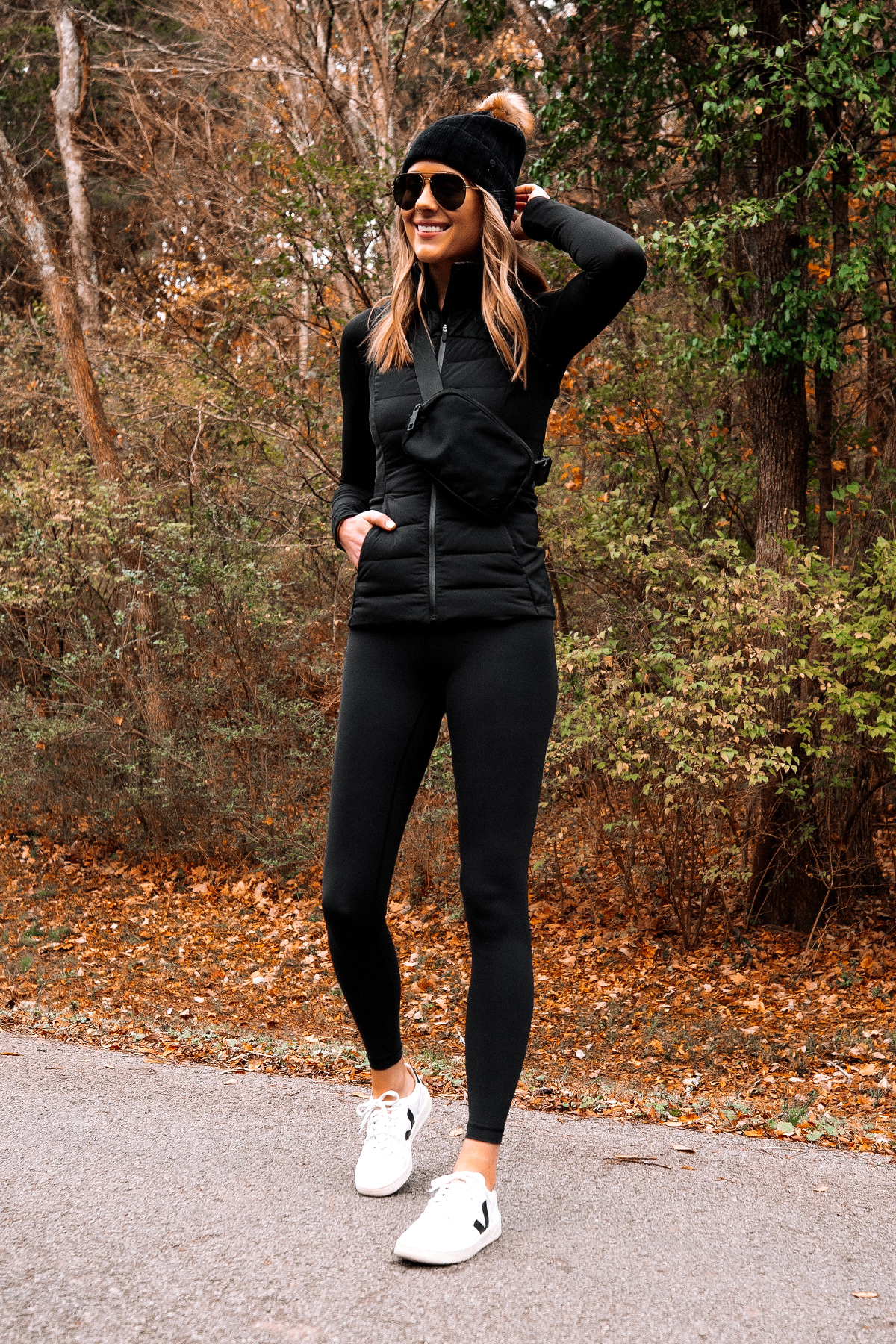 Fashion Jackson Wearing lululemon Black Beanie lululemon Black Vest lululemon Black Belt Bag lululemon Black Leggings Veja Sneakers 2