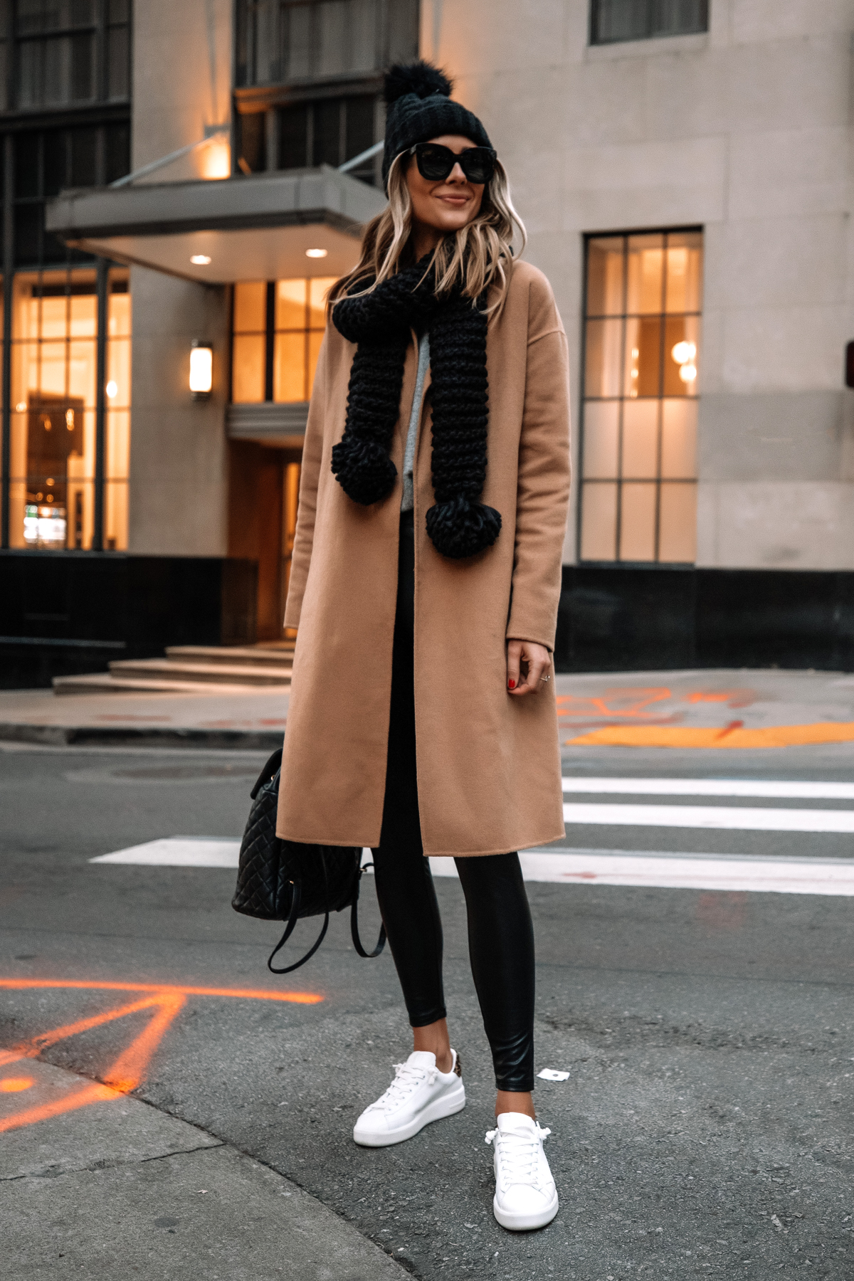 Fashion Jackson Wearing Express Camel Coat Black Faux Leather Leggings White Sneakers Black Scarf Black Beanie Street Style 1