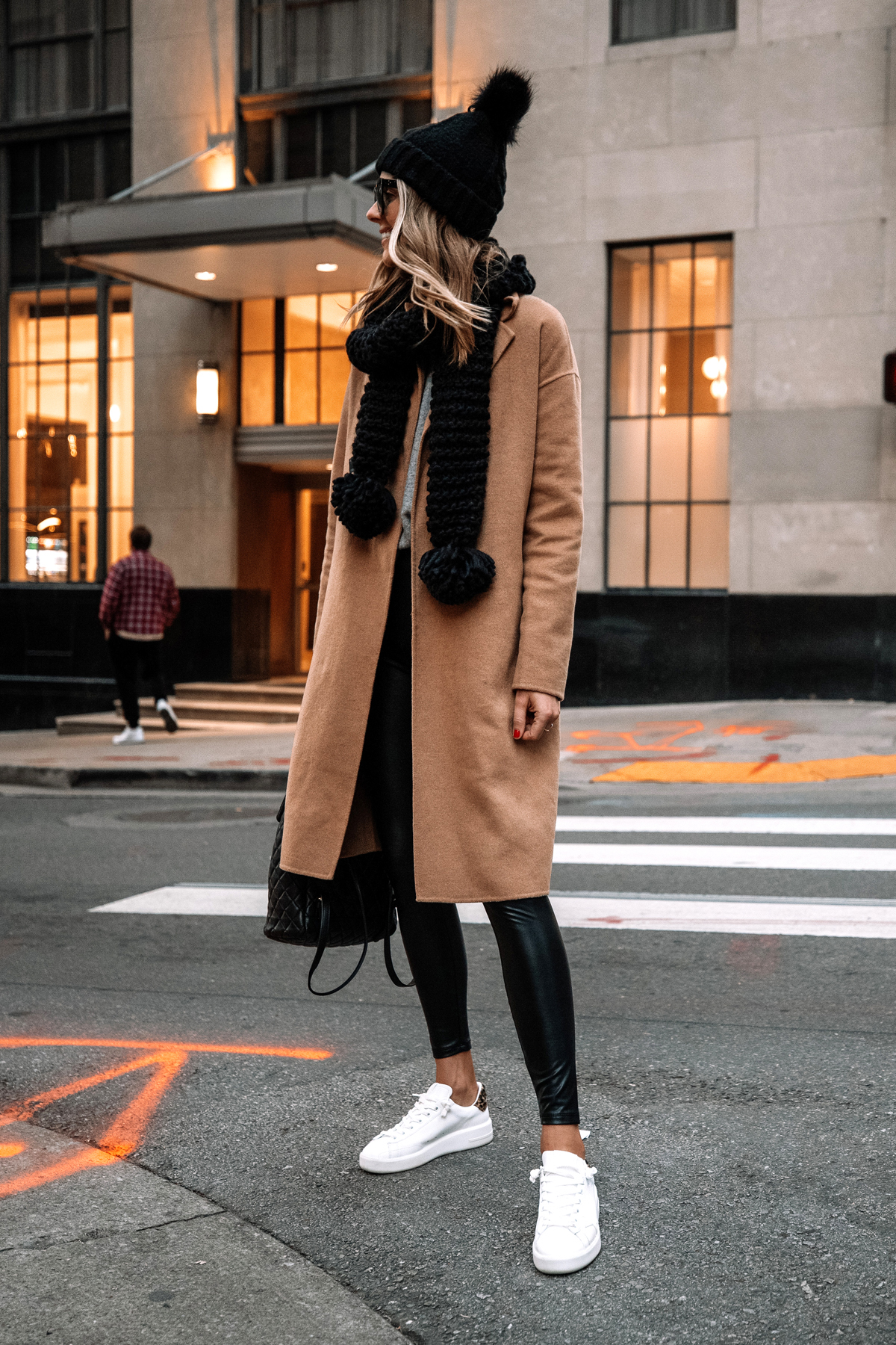 Fashion Jackson Wearing Express Camel Coat Faux Leather Leggings White Sneakers Black Scarf Black Beanie Street Style