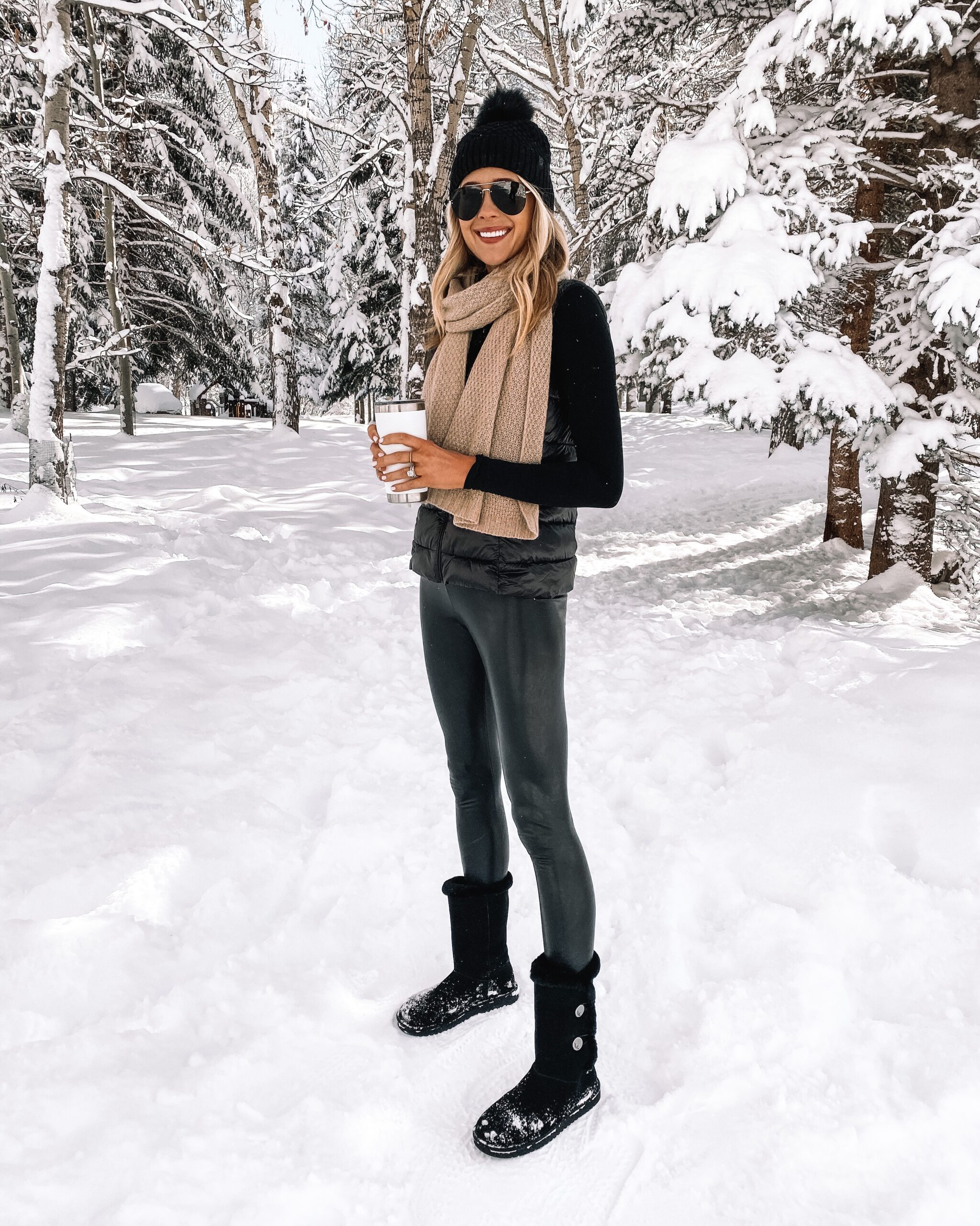 Fashion Jackson Wearing Commando Faux Leather Leggings Winter Outfit Black Puffer Vest Camel Scarf Black Beanie Black Snow Boots