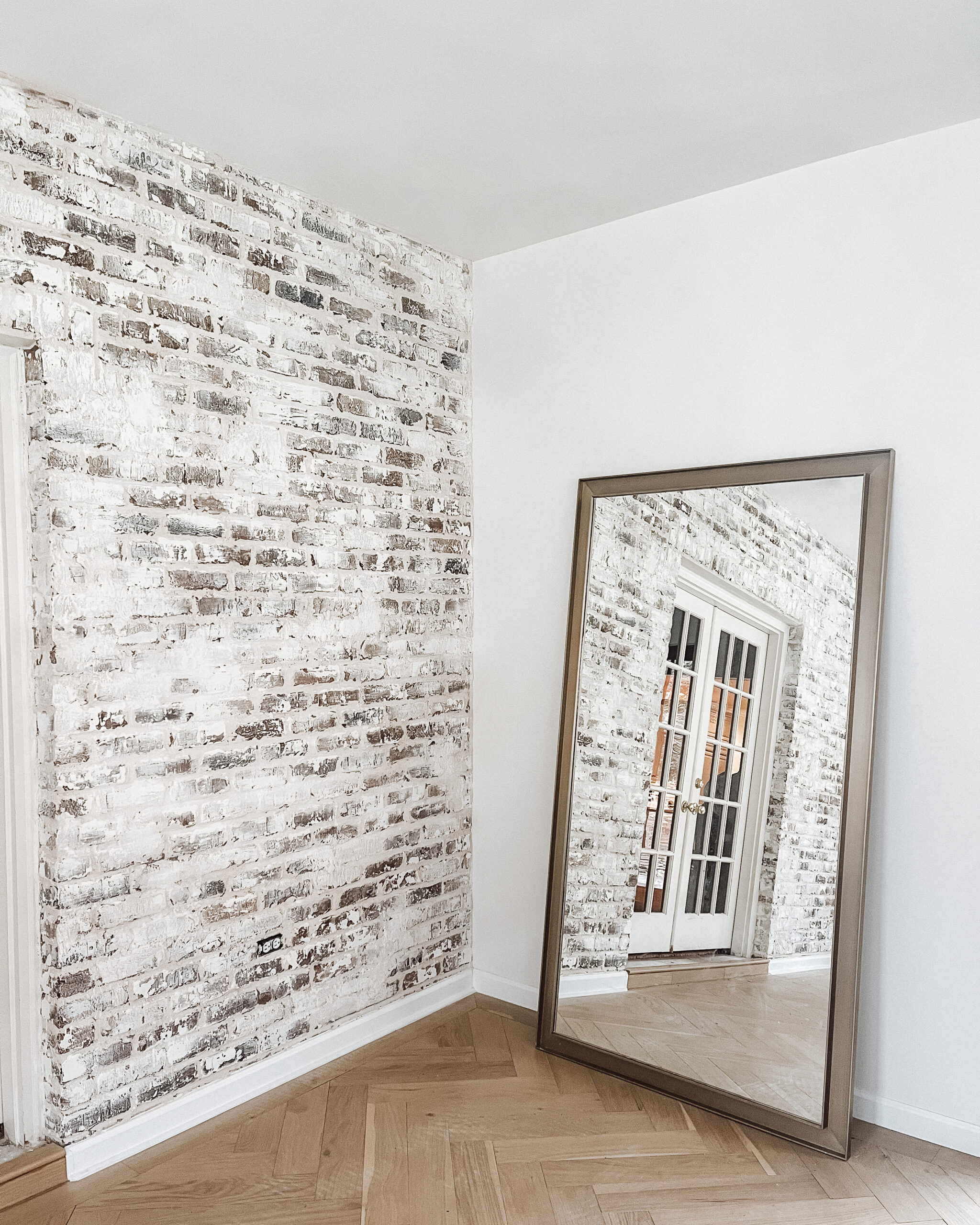 Emily Pope Harris White Brick Wall Renovation for Fashion Jackson