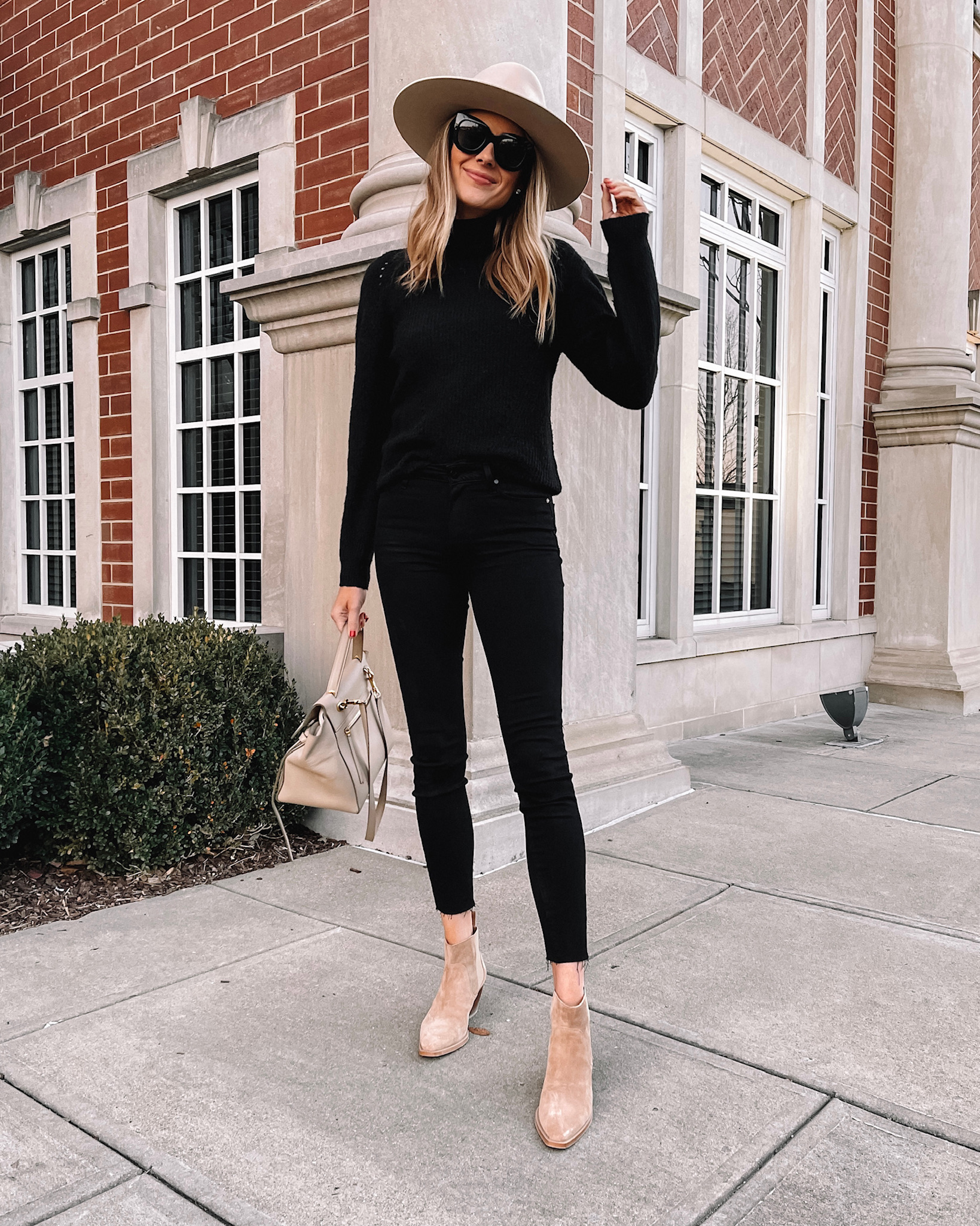 Fashion Jackson Wearing Black Sweater Black Skinny Jeans Beige Wide Brim Hat Tan Suede Booties