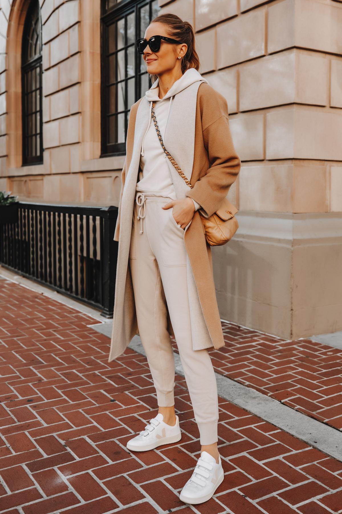 Fashion Jackson Wearing Camel Coat Beige Sweatshirt Beige Sweatpants Veja V-LOCK Sneaker Outfit 1