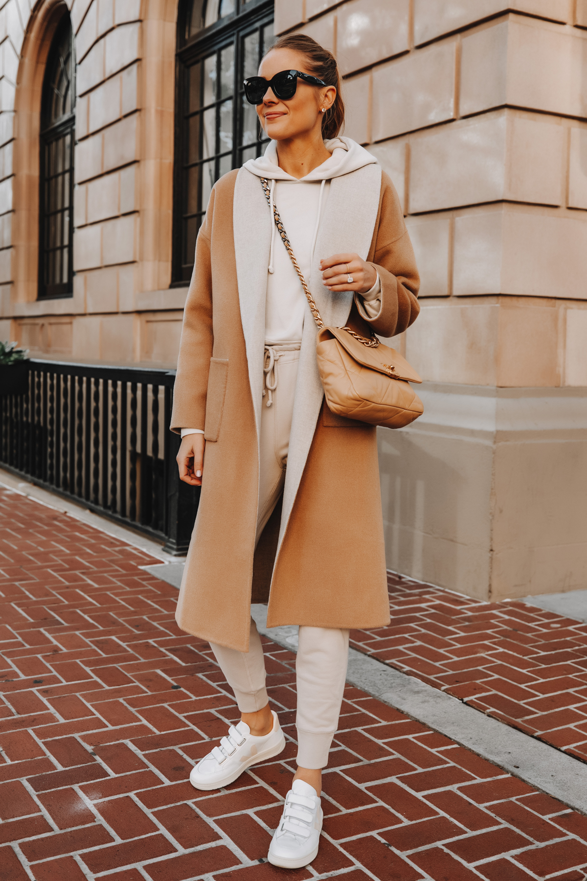 Fashion Jackson Wearing Camel Coat Beige Sweatshirt Beige Sweatpants Veja V-LOCK Sneaker Outfit 2