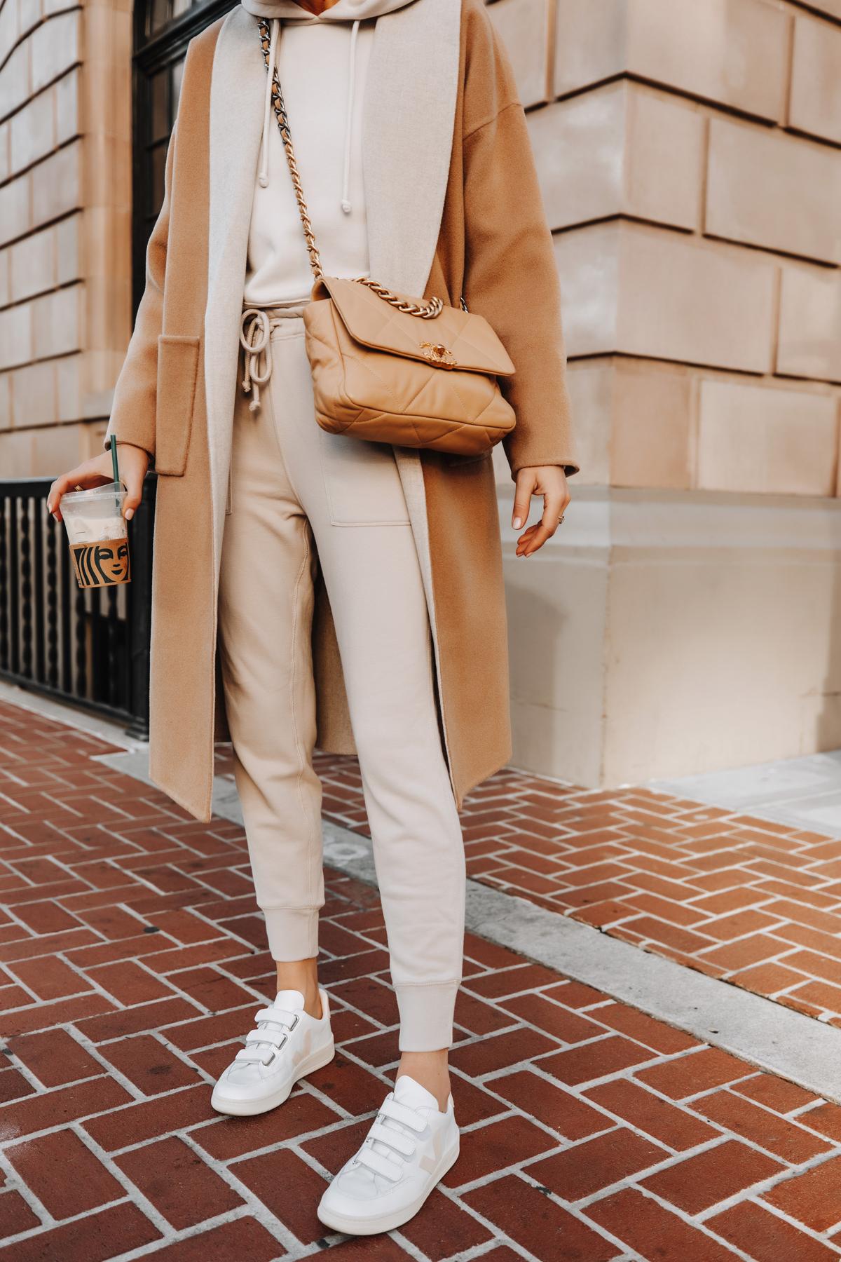Fashion Jackson Wearing Camel Coat Beige Sweatshirt Beige Sweatpants Veja V-LOCK Sneaker Outfit