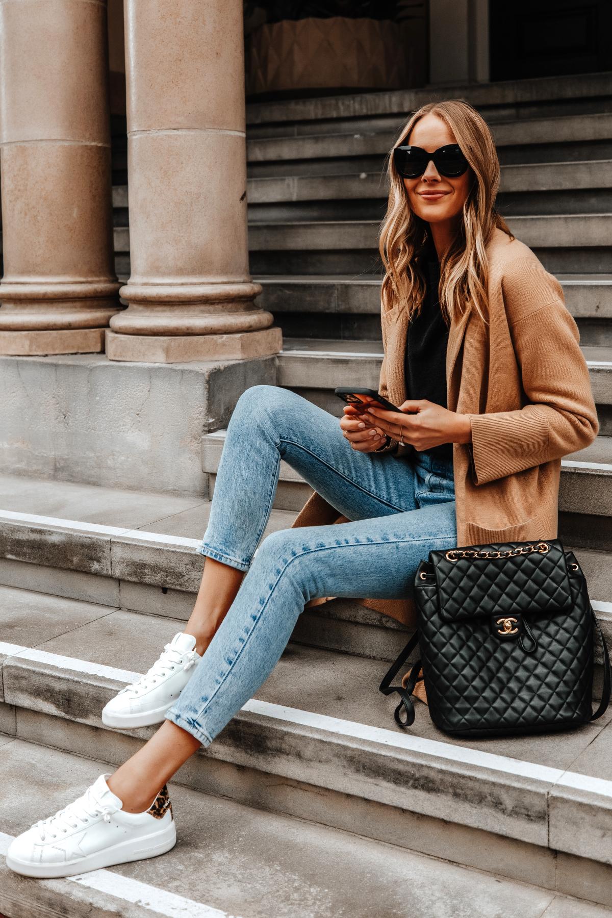 Fashion Jackson Wearing Camel Coatigan Black Sweater Levis Jeans Golden Goose Purestar White Sneakers Chanel Urban Spirit Large Backpack