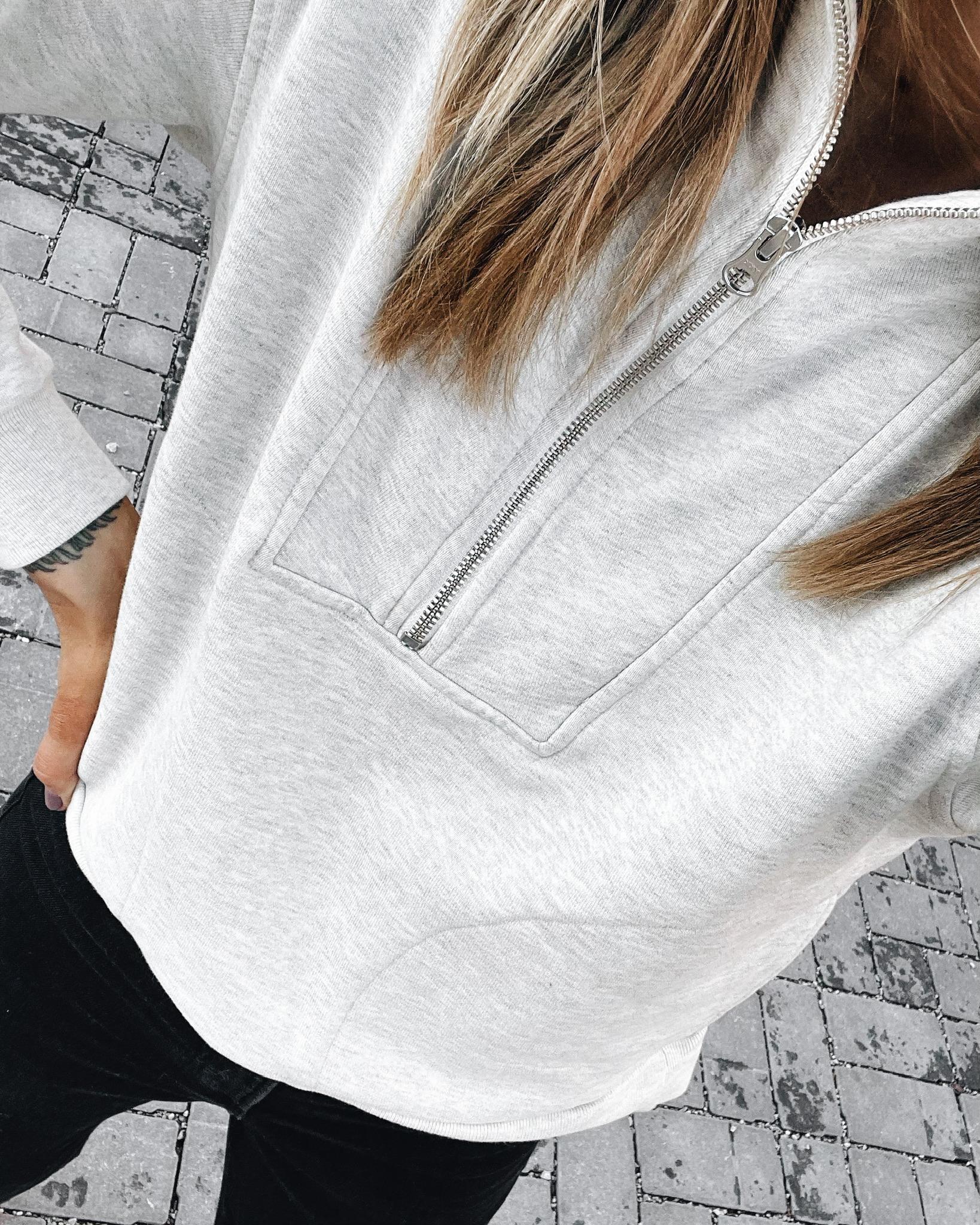 Fashion-Jackson-Wearing-Everlane-Half-Zip-Sweatshirt