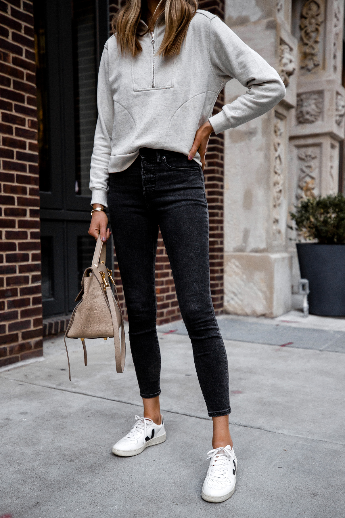 Fashion Jackson Wearing Everlane half Zip Sweatshirt Black Jeans Veja Sneakers Celine Mini Belt Bag