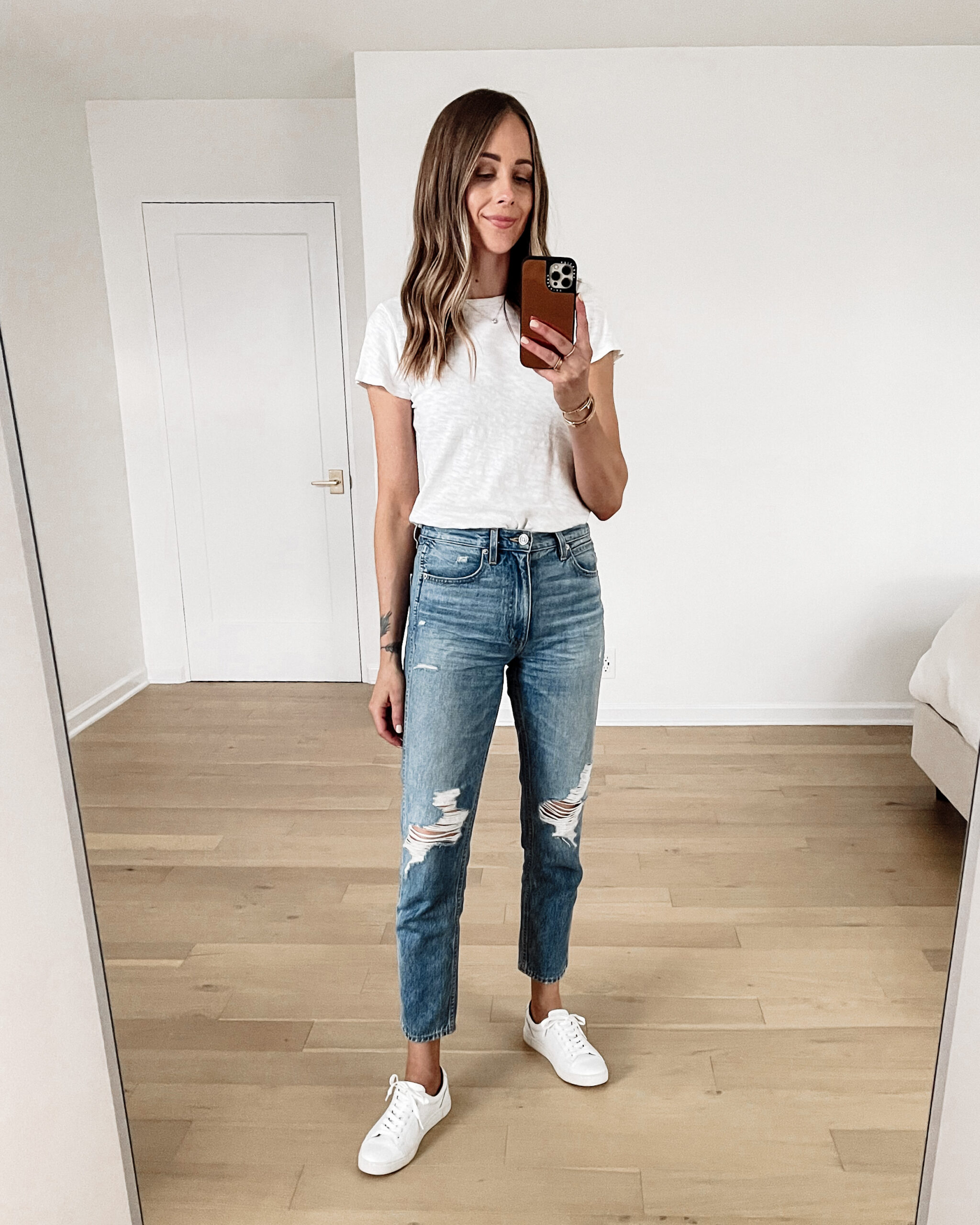 Fashion Jackson Wearing ATM White Tshirt SLVRLAKE Virginia Slim Ripped Jeans Frye White Sneakers