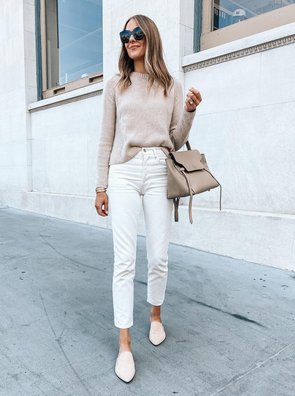 Fashion Jackson Wearing Jenni Kayne Oatmeal Fisherman Sweater White Jeans Beige Mules Celine Belt Bag Spring Outfit