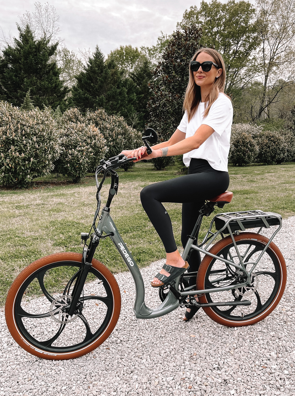 Fashion Jackson Wearing White Tshirt Black Leggings Birkenstock Sandals Riding Pedego Electric Bike