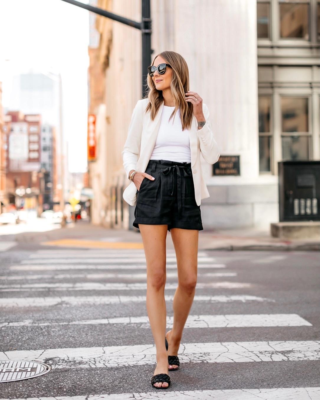 Fashion Jackson Wearing Express White Blazer White Bodysuit Black Tie Waist Shorts Black Heels Modern Workwear Outfit