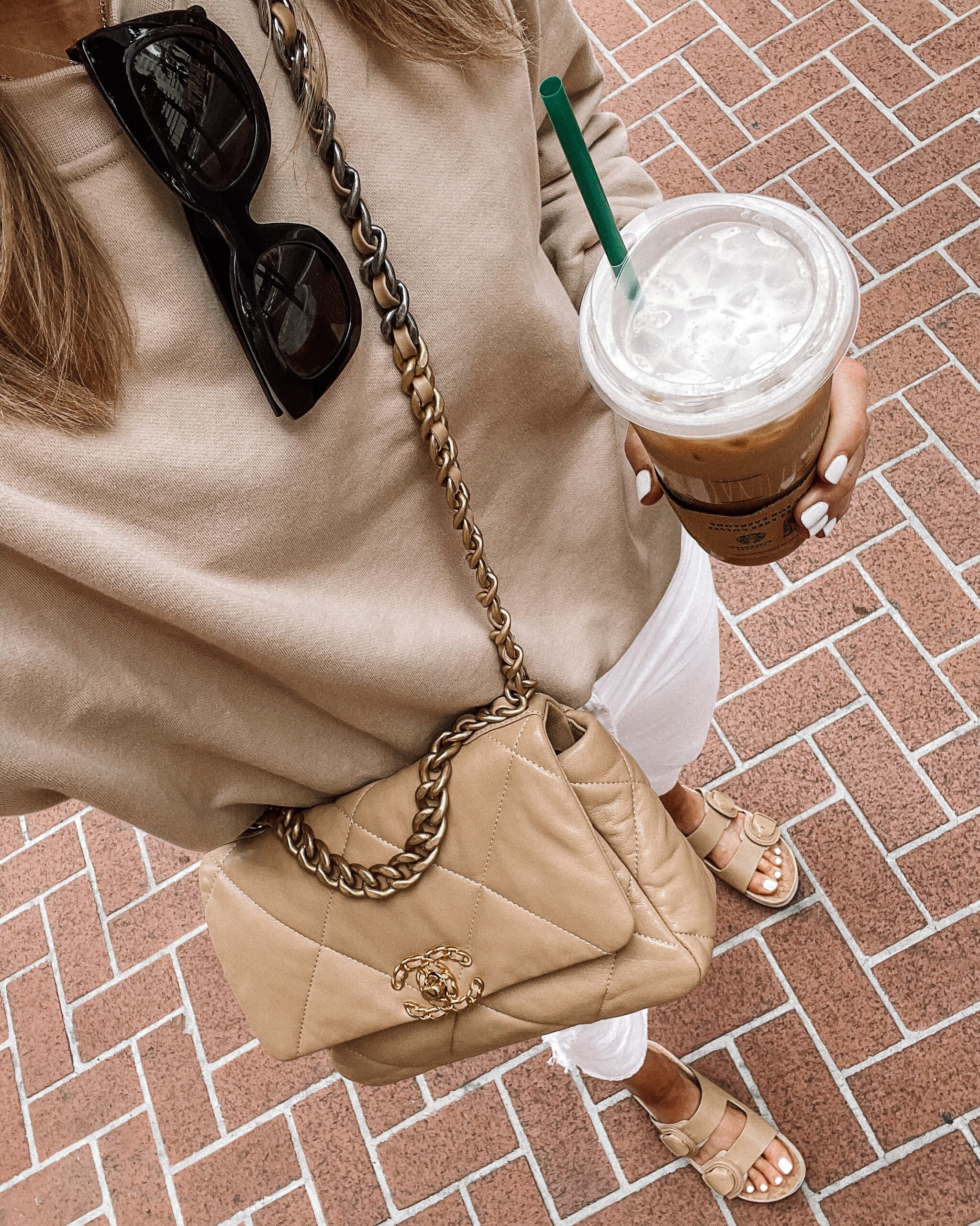 Fashion Jackson Wearing Tan Sweatshirt White Jeans Tan Slide Sandals Tan Chanel Handbag