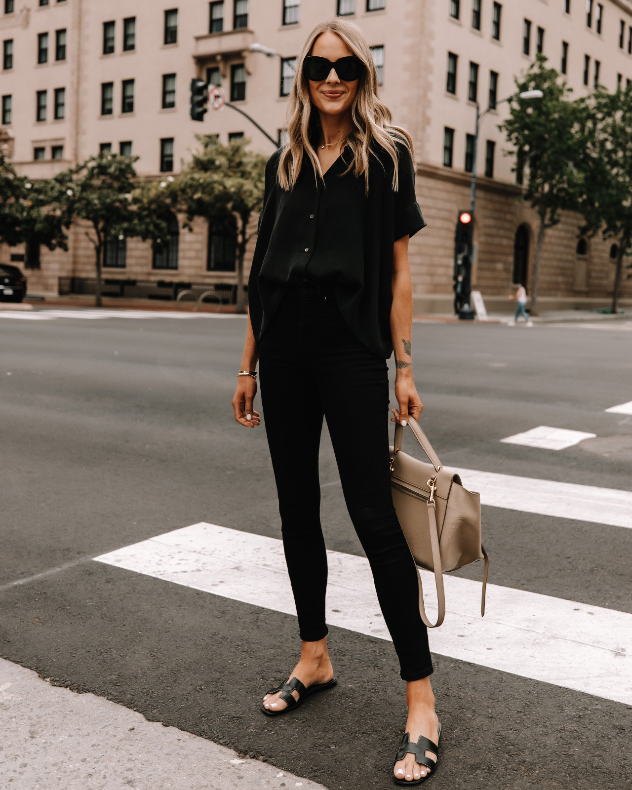 Fashion Jackson Wearing Everlane Black Button Down Shirt Everlane Black Skinny Jeans Hermes Oran Black Sandals Celine Taupe Belt Bag Street Style 2