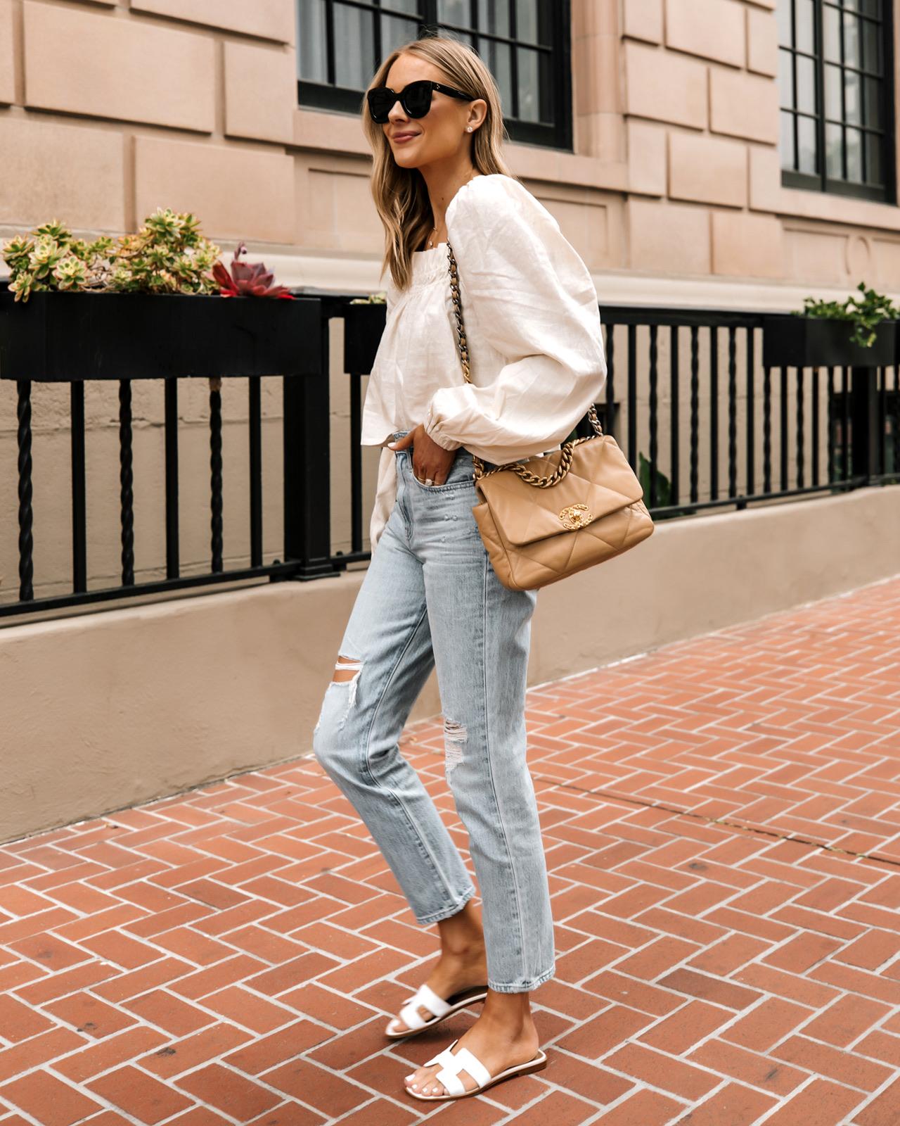 Fashion Jackson Wearing Beige Linen Puff Sleeve Top Madewell Ripped Jeans Hermes White Sandals Chanel 19 Beige Handbag