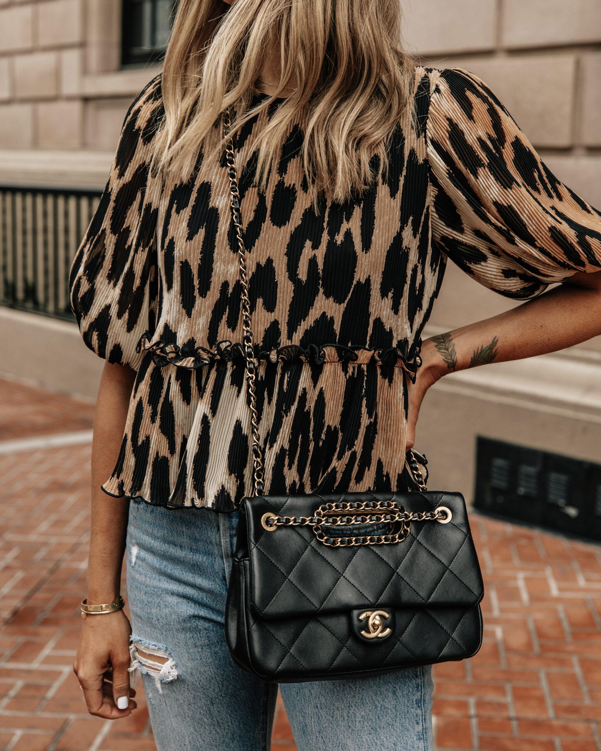 Fashion Jackson Wearing Ganni Leopard Top Levis Ripped Jeans Black Chanel Handbag 1