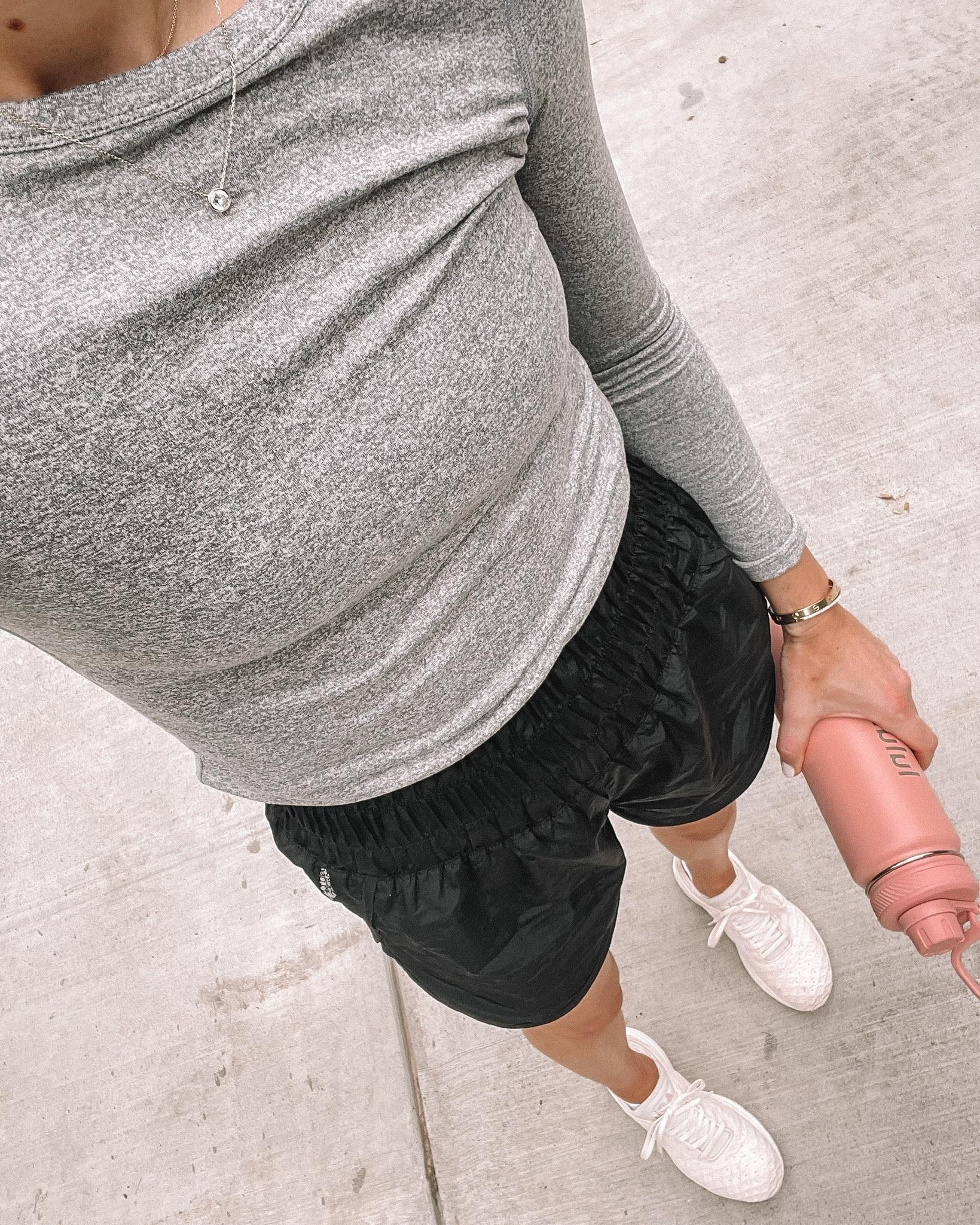 Fashion Jackson Wearing Long Sleeve Grey Workout Top Free People Black Workout Shorts APL Sneakers Pink lululemon Water Bottle