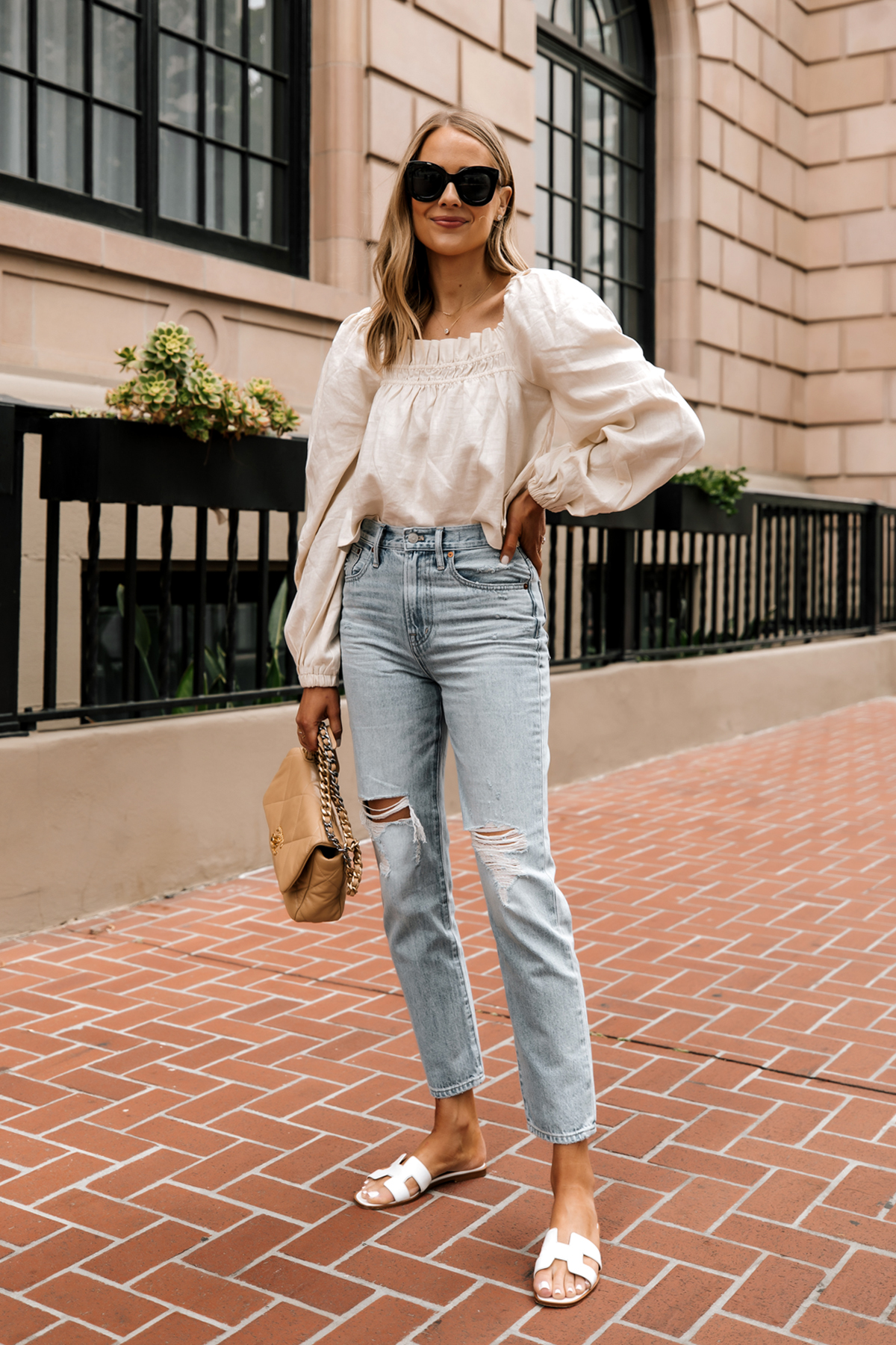 Fashion Jackson Wearing Beige Linen Puff Sleeve Top Madewell Ripped Jeans Hermes White Sandals Chanel 19 Beige Handbag 2