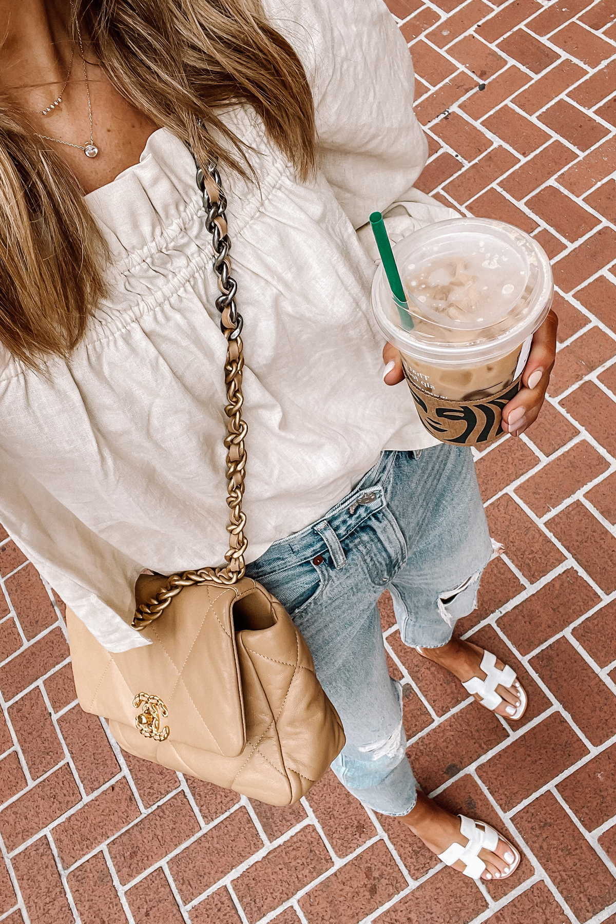 Fashion Jackson Wearing Beige Linen Puff Sleeve Top Madewell Ripped Jeans Hermes White Sandals Chanel 19 Beige Handbag 3
