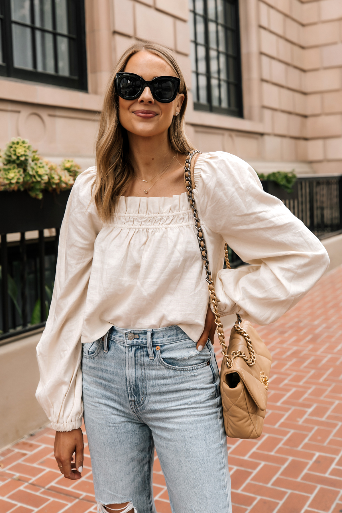Fashion Jackson Wearing Beige Linen Puff Sleeve Top Ripped Jeans Chanel Beige Handbag