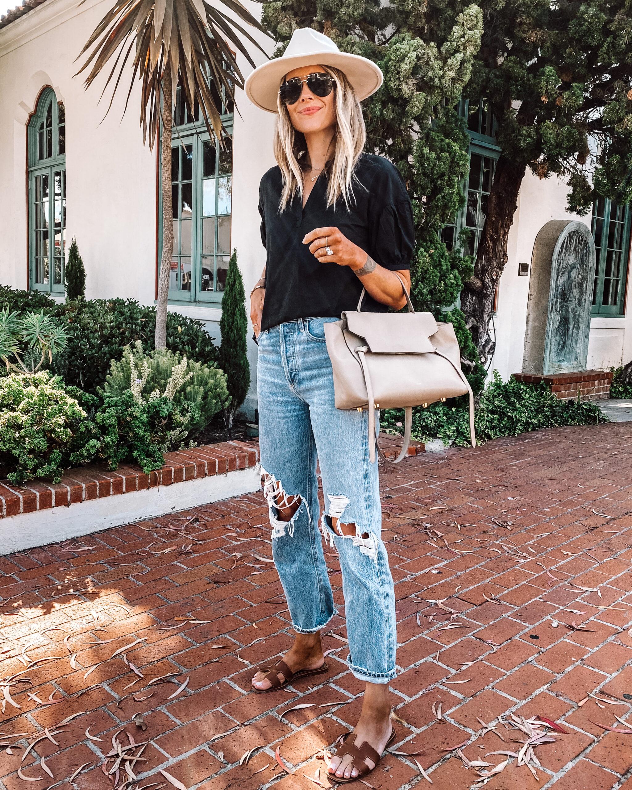 Fashion Jackson Wearing Black Puff Sleeve Shirt AGOLDE 90s Ripped Jeans Beige Hat Hermes Tan Sandals Celine Mini Belt Bag Summer Outfit