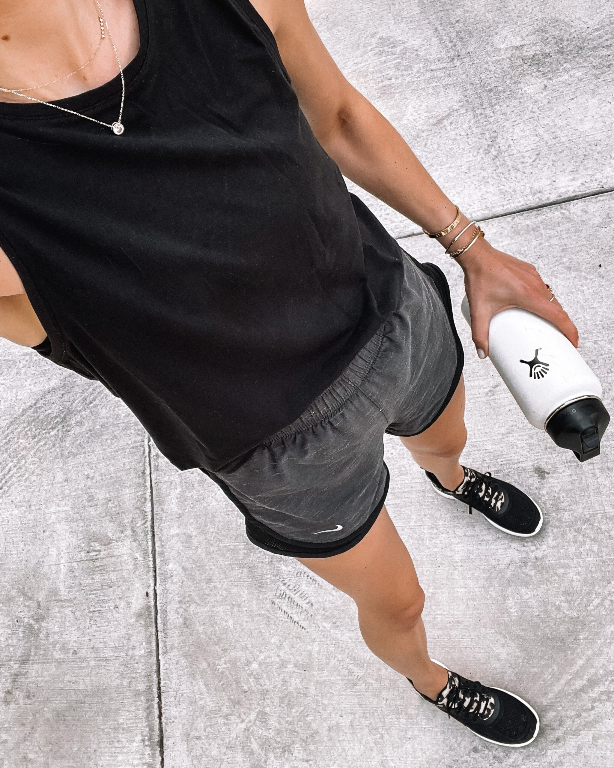 Fashion Jackson Wearing Black Workout Tank Nike Running Shorts with Liner APL Black Leopard Sneakers White Hydroflask Womens Workout Outfit