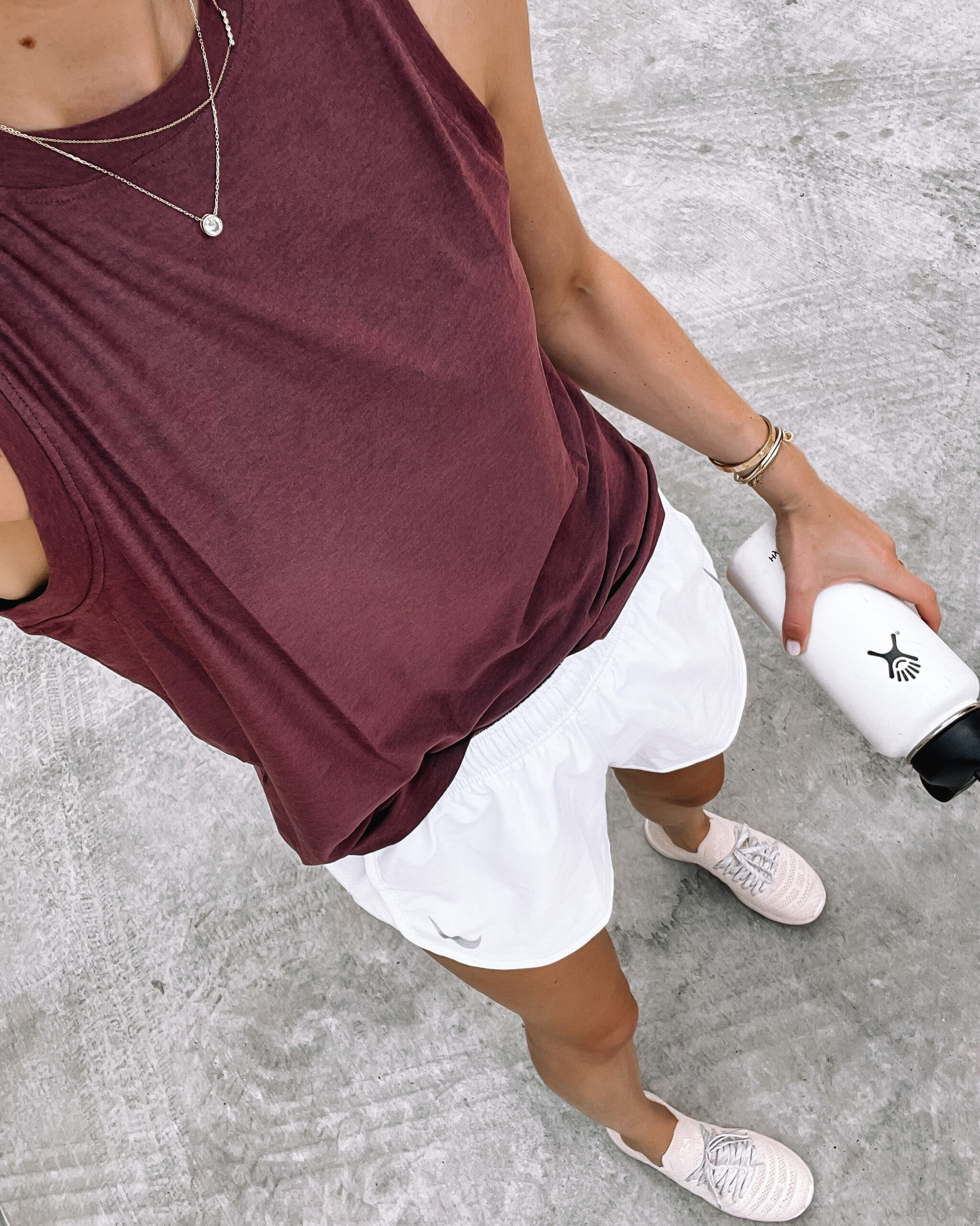 Fashion Jackson Wearing Pink Muscle Workout Tank White Nike Running Shorts With Liner Blush APL Sneakers White Hydroflast Womens Workout Outfit