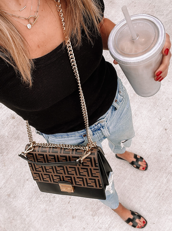 Fashion Jackson Wearing Black Scoop Neck Top Ripped Jeans Hermes Black Oran Sandals Fendi Kan U Handbag