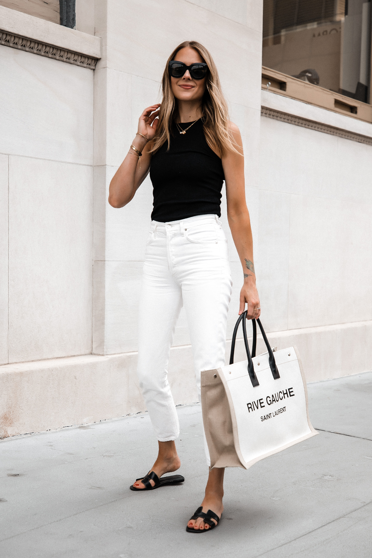 Fashion Jackson Wearing Black Tank White Skinny Jeans Hermes Oran Black Sandals Saint Laurent Rive Gauche Logo Tote Bag Street Style 1