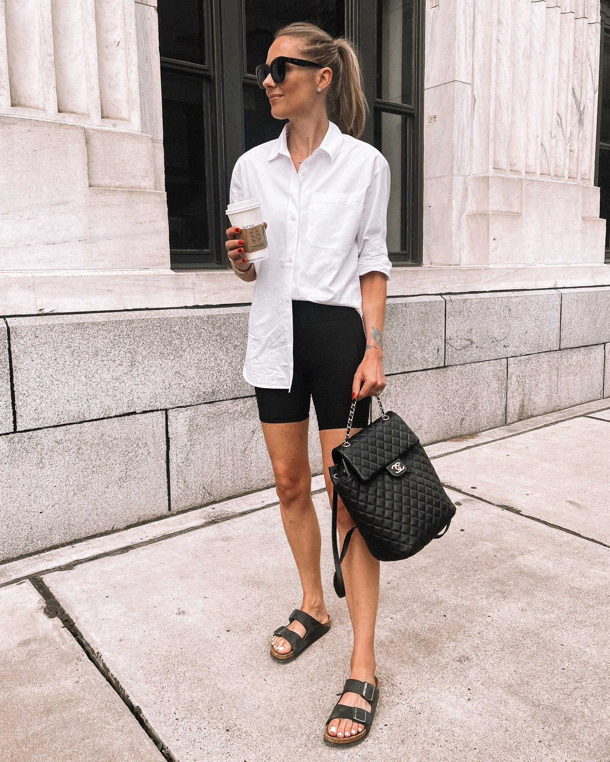 Fashion Jackson Wearing Jenni Kayne White Button Up Shirt lululemon Black Biker Shorts Blakc Birkenstock Sandals Chanel Black Backpack Summer Outfit 1