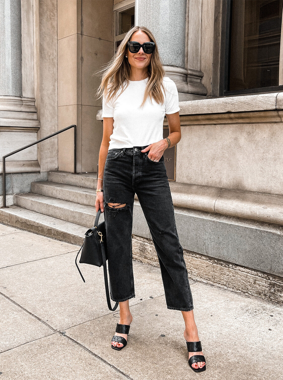 Fashion Jackson Wearing White Tee Black Ripped AGOLDE Jeans Black Heeled Sandals