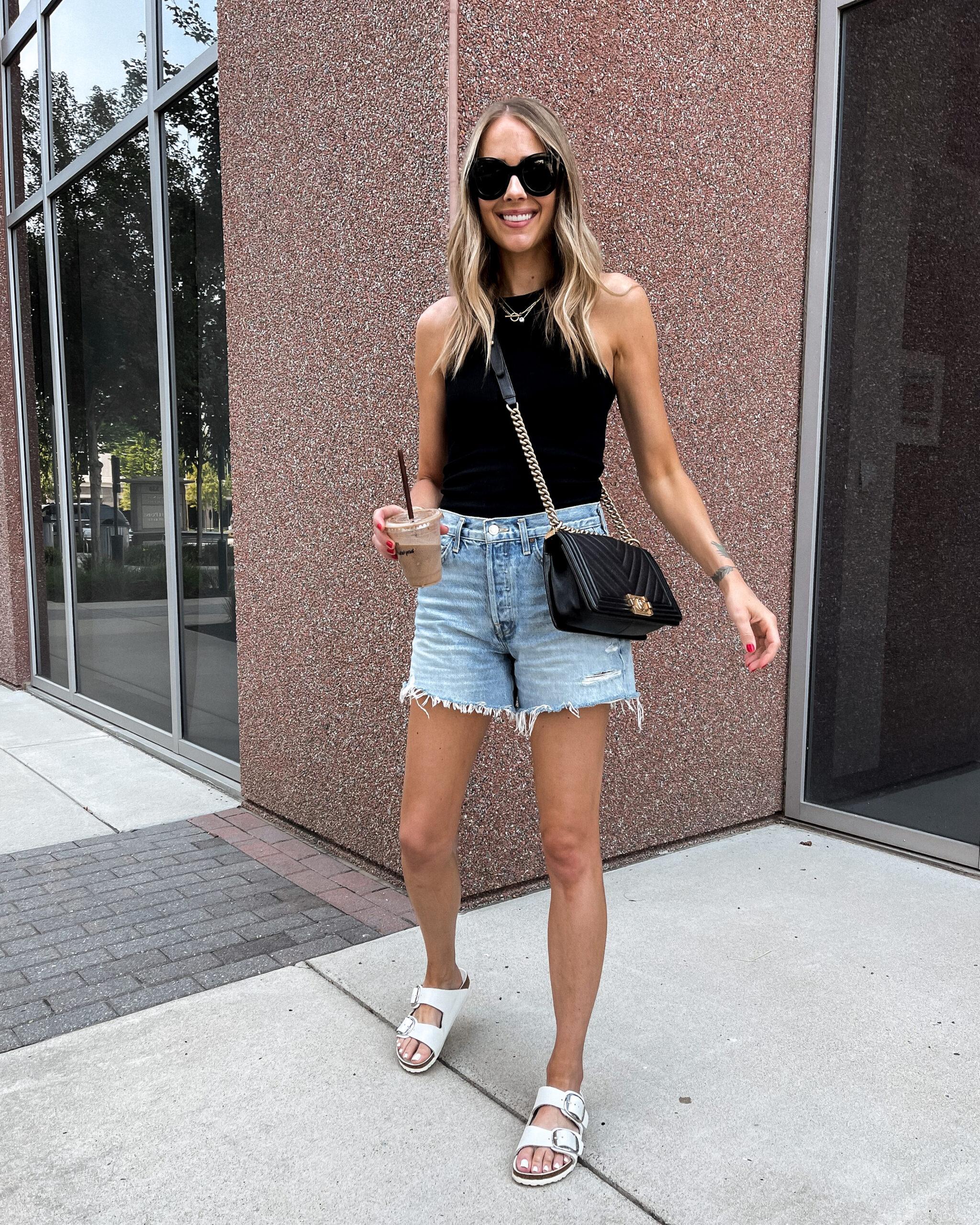 Fashion Jackson Wearing Black Tank AGOLDE Ripped Denim Shorts White Birkenstock Sandals
